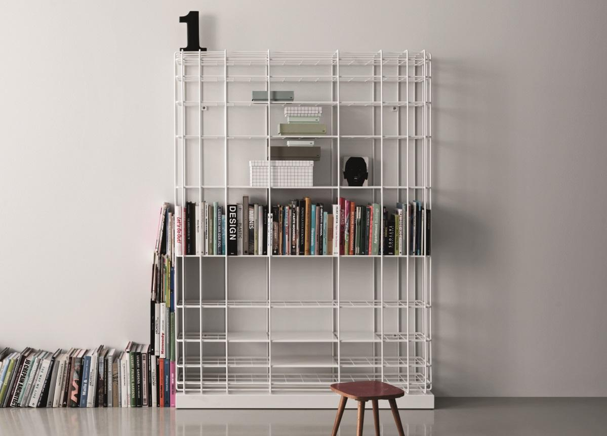 Leyva Freestanding Bookcase -  Leyva is a latticework bookcase in coated and soldered tubular iron with a clean-cut and essential silhouette. Its willowy minimal contours conjure up an airy lightness. Whether it is wall-mounted or free-standing, it will easily blend into any setting.   Perfect for modern settings and a seamless solution for industrial surrounds, it could also bestow an unexpected twist on more classical décor.   Materials:   White or grey coated 10mm iron rod.  Moveable 1.5 mm sheet-metal shelves 5 mm inner mesh.  The bookcase base is made from coated sheet metal  Standing bookcase: height cm 210 width cm 150 depth cm 30  Wall-attached bookcase: height cm 150 width cm 150 depth cm 30  | Matter of Stuff