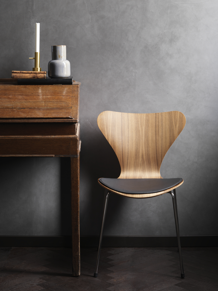 Series 7 Chair - <p>Designed by Arne Jacobsen in 1955, the Series 7 chair is a further development of the classic Ant chair.<br /> The four-legged Series 7 chair represents the culmination of the pressure-moulding technique that Søren Hansen, founder Fritz Hansen's grandson, spent the 1920s and 30s refining.<br /> The iconic shape of the Series 7 is the result of Arne Jacobsen's exploration of the possibilities of steam-bent veneer.</p> <p>The best selling chair in Fritz Hansen's history comes in 3 different finishes: Natural veneer, coloured ash or lacquered.<br /> All chairs are made of pressure moulded sliced veneer with a base of chromed steel.<br /> The shell is also available in front- or fully upholstered versions in a wide range of fabrics and leather types.</p> <p>A range of materials and colours are available in a number of combinations. Prices may vary.<br /> Please enquire for full details.</p>  | Matter of Stuff