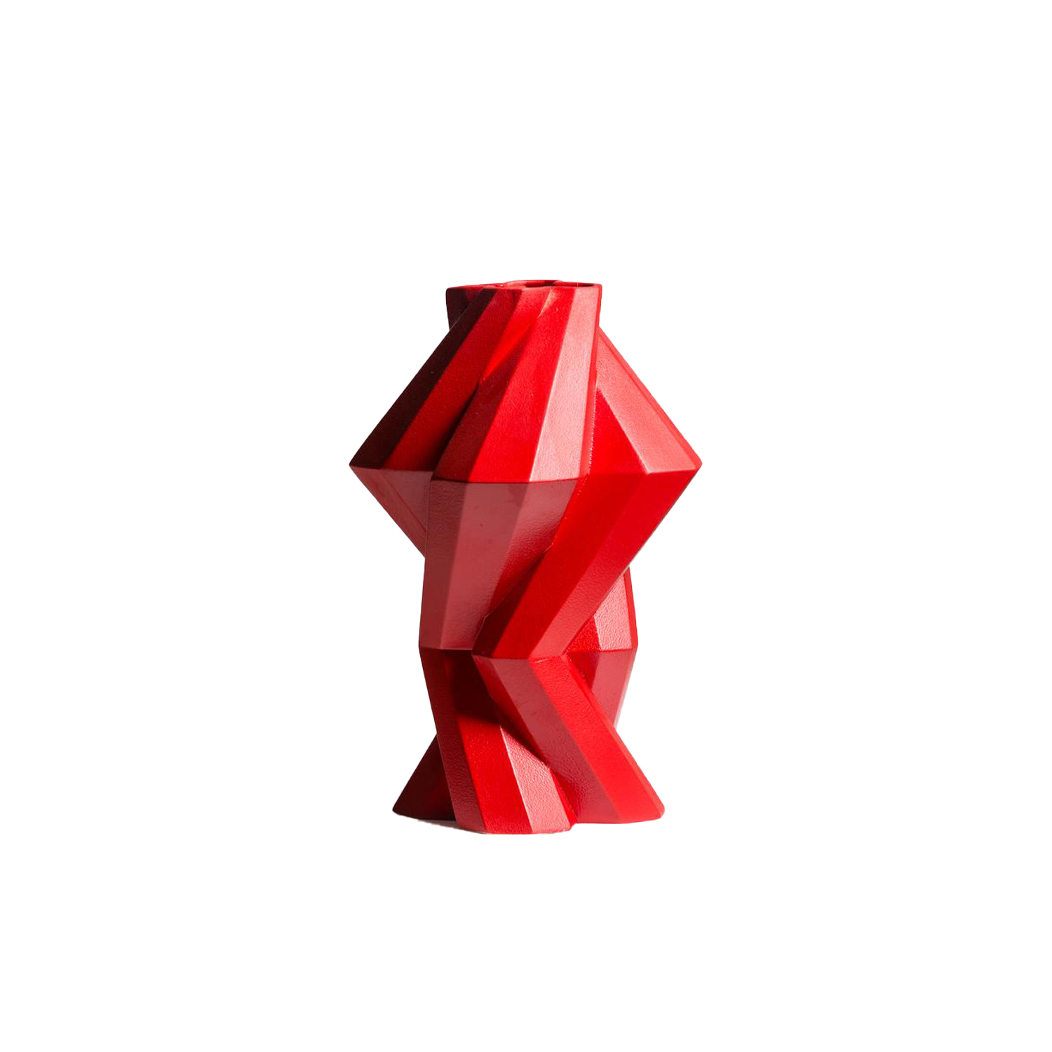 Fortress Column Vase Red - Designer Lara Bohinc explores the marriage of ancient and futuristic form in the new Fortress Vase range, which has created a more complex geometric and modern structure from the original inspiration of the octagonal towers at the Diocletian Palace in Croatia. The resulting hexagonal blocks interlock and embrace to allow the play of light and shade on the many surfaces and angles. There are four Fortress shapes: the larger Column and Castle (45cm height), the Pillar (30cm height) and the Tower vase (37cm height). These are hand made from ceramic in a small Italian artisanal workshop and come in three finishes: dark gold, bronze and speckled white.  | Matter of Stuff