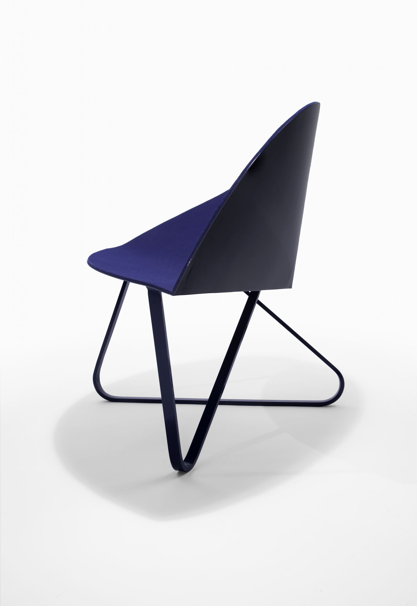 Curved Lounge Chair - <p>In continuation of my research of planar material, I refined a single broad bend in creating the shell for a lounge chair. Cutting a pie shape away from a circle and curving it to connect the edges creates the three dimensional chair shell. The wide seat invites users to have freedom with their posture, and the long line of the outside curve functions as a armrest. The form of the legs echos the chair shell's perimeter.</p>  | Matter of Stuff