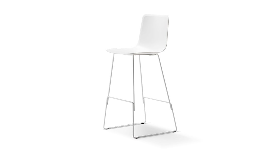 Pato Sledge Barstool Seat Upholstered - Pato is a carefully crafted multipurpose chair in eco-friendly polypropylene that can be used outdoors. The chair is available with a range of optional features including coupling. The chair can be tuned from basic to exclusive with optional upholstery.  Pato is a prime example of our focus on sustainability and protecting the environment, reflected in a chair that's 100% renewable and recyclable. All components can be incorporated into future furniture production, thus contributing to a circular economy by minimising the use of materials, resources, waste and pollution.   Merging traditional production methods with cutting-edge technology, Pato is a human-centric, highly versatile series of multi-purpose functional furniture that draws on our in-depth experience with materials, immaculate detailing and heritage of fine craftsmanship. Allowing us to apply our high standards of texture, finish and carpentry techniques to an array of materials in addition to wood for products aimed at a mass market.   With its clean lines and curves, Pato echoes the ethos of Danish-Icelandic design duo Welling/Ludvik. Demonstrating their belief that good design has the ability to be interesting, even when reduced to its most simple form. Where anything extraneous is eliminated and every detail has a purpose.   Together we spent nearly three years developing the shell structure to have a soft surface that's also wear and tear resistant. Enhancing the chair's ability to optimally conform to the user's body is a subtle beveled edge. A technique from classic cabinetmaking, which gives the chair a sense of handcrafted finesse. Each Pato is detailed and finished by hand by our highly skilled crafts people, who refine the beveled edge and the silky, resilient surface. Setting a new standard for the execution and finish of polypropylene.   Since the success of its initial launch, we've expanded Pato into an extensive collection of variants, featuring ar