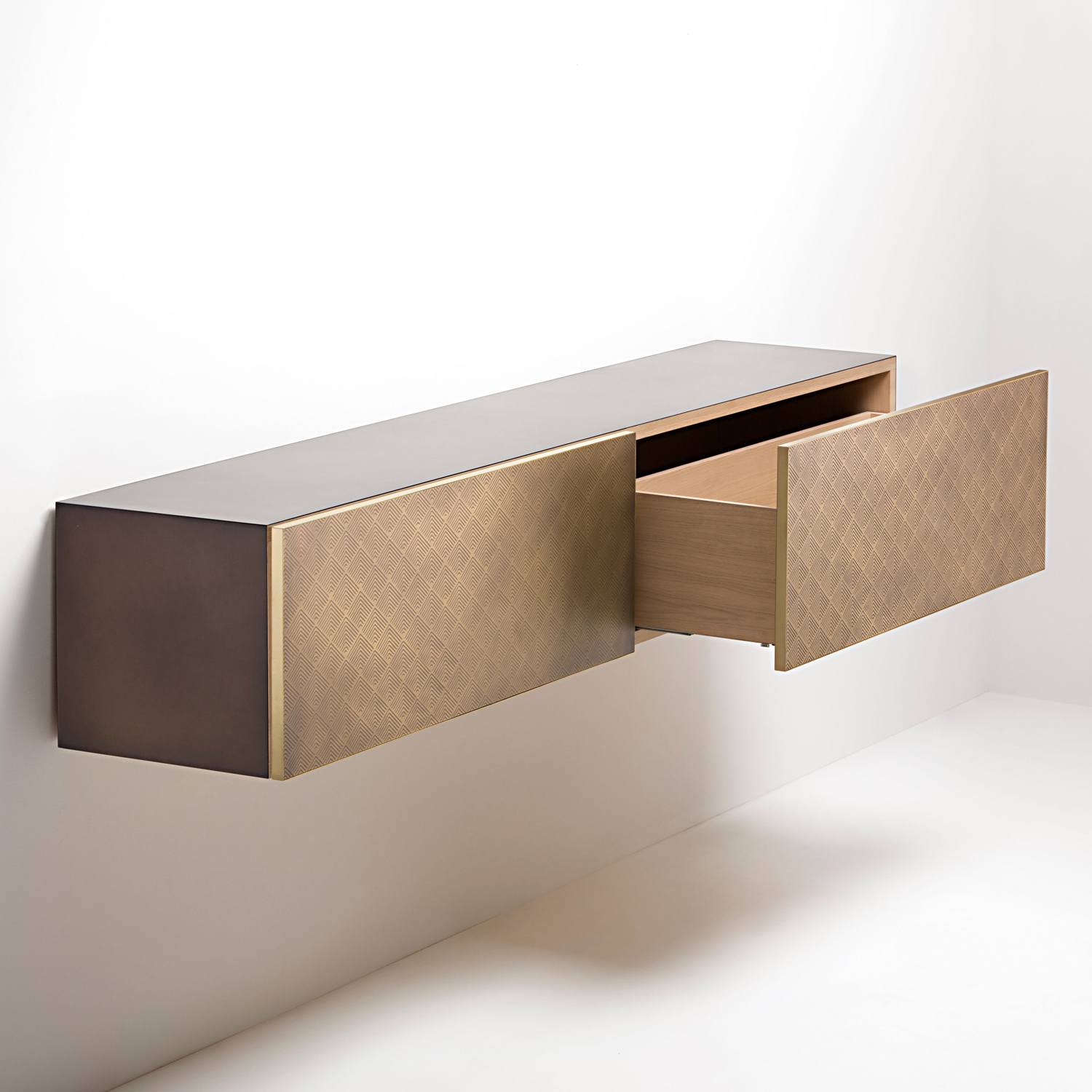 Tako Sideboard - Clean volumes for a console with quite simple lines, emphasising the nobility of the metals that clad the large faces of the drawers. Available both in a hanging and free-standing version, Tako evokes the delicate decoration anointed by the DeErosion finish, for a vaguely-Japanese inspired pattern that filters light, modulating its reflections.  Hanging or free-standing metalsideboard, characterised by two or onelarge pull-out drawers. Iron frame with a natural oak inner structure. The drawers are available in different finishes and materials.   | Matter of Stuff