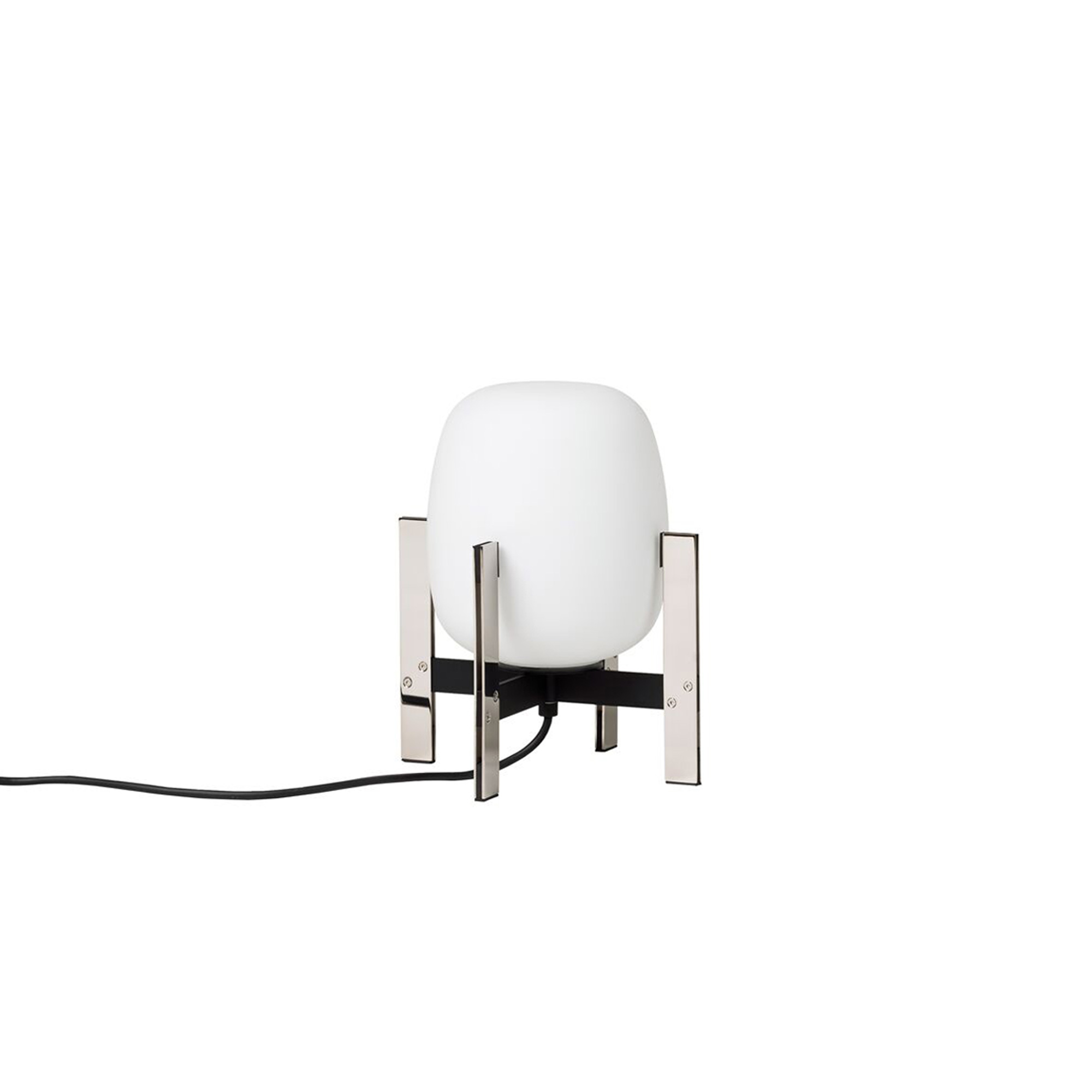 Cestita Metálica Table Lamp - The Cestita Metálica is meant to stay put, hence it's lack of a handle. Miguel Milá mastered the strength of steel by placing at its centre a delicate opal glass silhouette. A seamless expression of strength and emotion, combined with everyday practicality. Just like its bigger sister, the Cestita can be positioned in any corner or shelf, enhancing everything it illuminates. The lantern is produced and assembled manually by European craftsmen, using traditional glass blowing techniques for its opal shade.  | Matter of Stuff