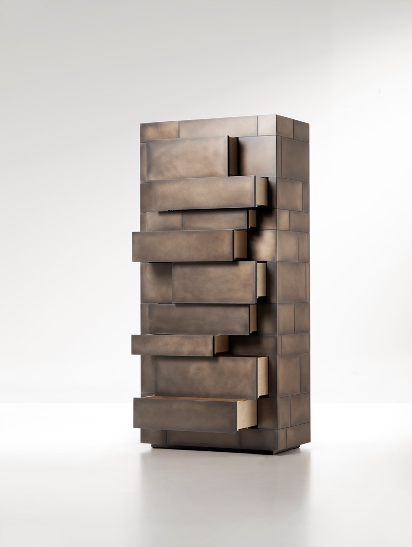 Celato Chest of Drawers - Celato is a reference to what is concealed to keep a memory intact; it's an archetype in which beauty is revealed in stages. A monolithic appearance makes Celato a contemporary menhir; like a legend that tells of magnificent treasures safeguarded below sacred stones, Celato reveals its dual soul, with many internal, hidden, almost secret spaces. It combines several tesserae to form a whole: aesthetics, function and an incredible ability to make each piece unique, never identical to the next, which is revealed without impudence, walking an avant-garde line between tradition and modernity.  Chestof drawers clad in metal on allsides. Invisible drawers with push-opensystem mounted on full-extensionBlum Blumotion slides. Inner structure in natural birch. | Matter of Stuff