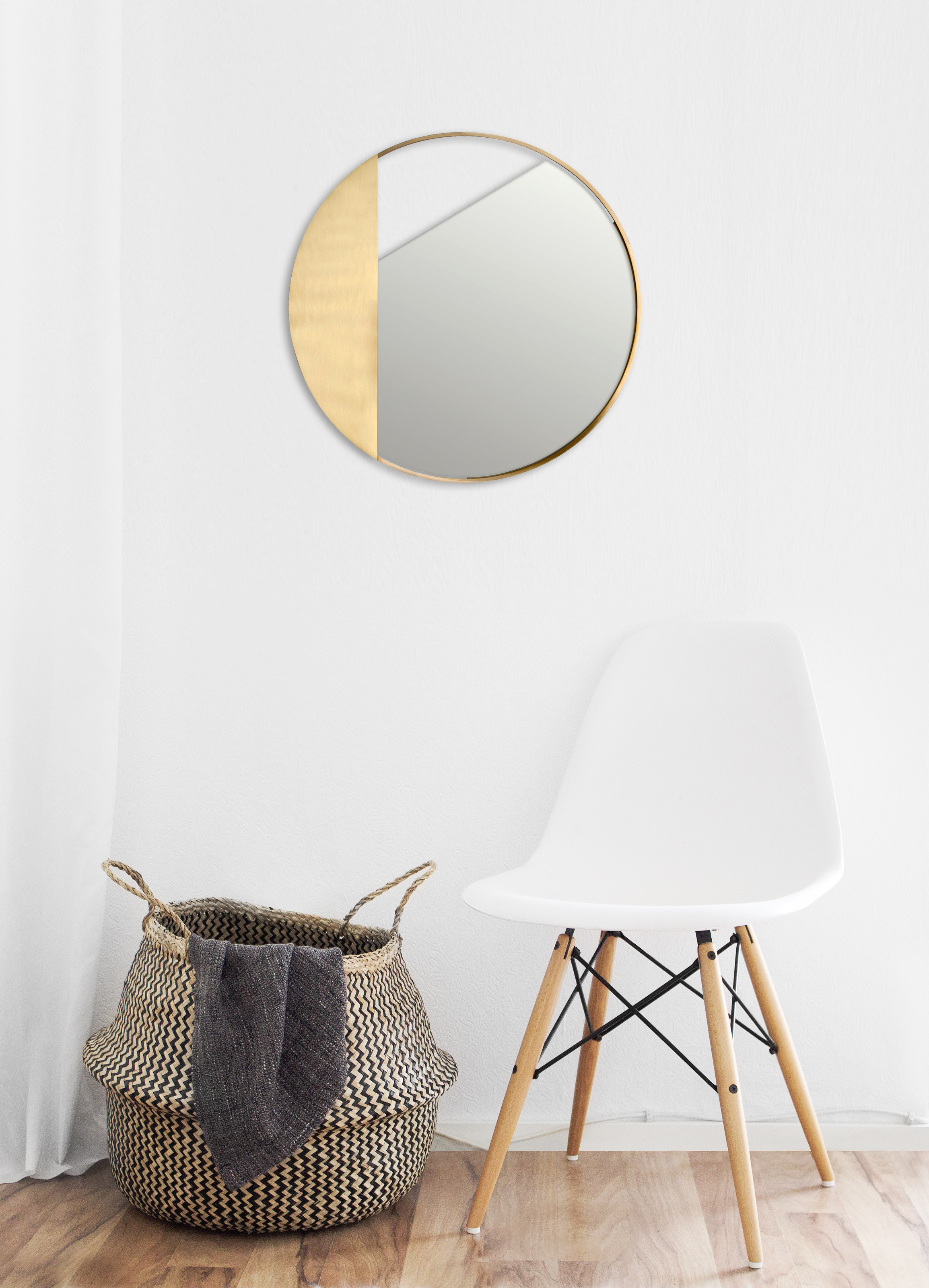 Revolution Mirror no.1 - Three wall mirrors characterized by a clean and rigorous design. The frame in brushed brass encloses a round mirror, mounted at different angles to create a new design every time. The balance created between the parts creates a delicate graphic effect that transforms the mirror into a sort of wall jewel. Handmade in Italy by skilled craftsmen.  | Matter of Stuff