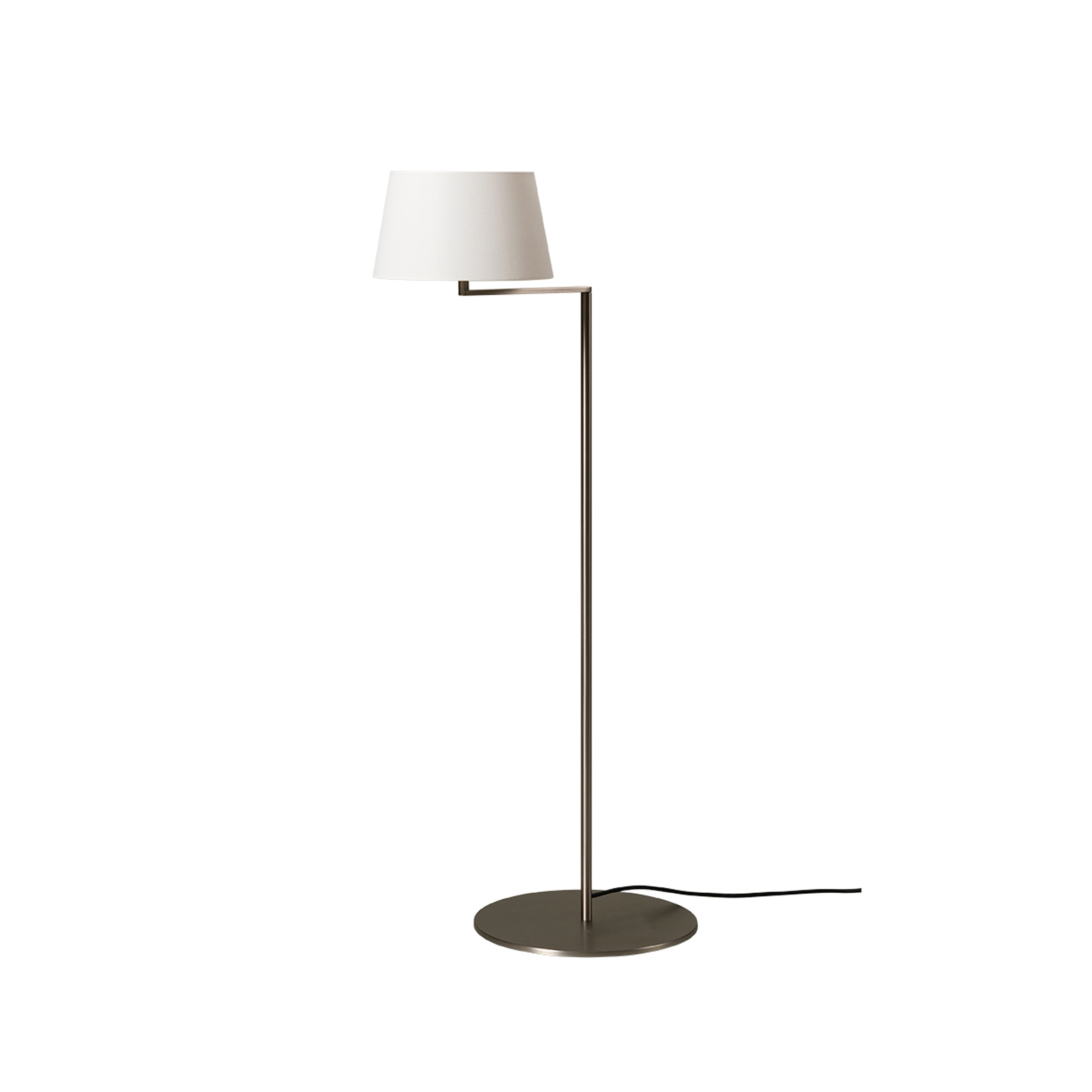 Americana Floor Lamp - Enthralled by the idea of enhancing Hansen's remarkable geometry, Milá's Americana series is also based on a swing arm, although here the arm is a single section with a right-angled bend. Accordingly, the head of the shaft becomes the swivel that enables the shades horizontal rotation, reducing the lever effect. The arm can be moved towards you or away from you without shifting the large metal base, evoking the swing motion.  | Matter of Stuff