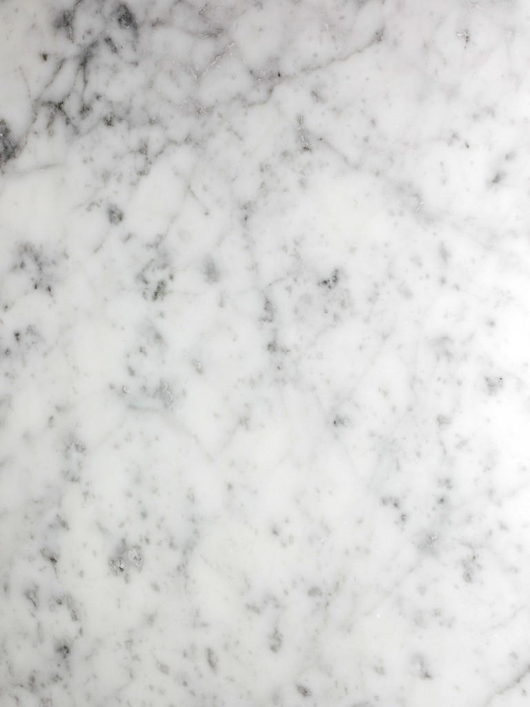 Bianco Carrara C Marble - Sourced from our craftsmen quarries in Tuscany. Marble Bianco Carrara C is the most refined and precious quality of Carrara marble. Characterised by pure white color and light grey veins.  Bianco Carrara C is perfect for indoor and outdoor use. | Matter of Stuff