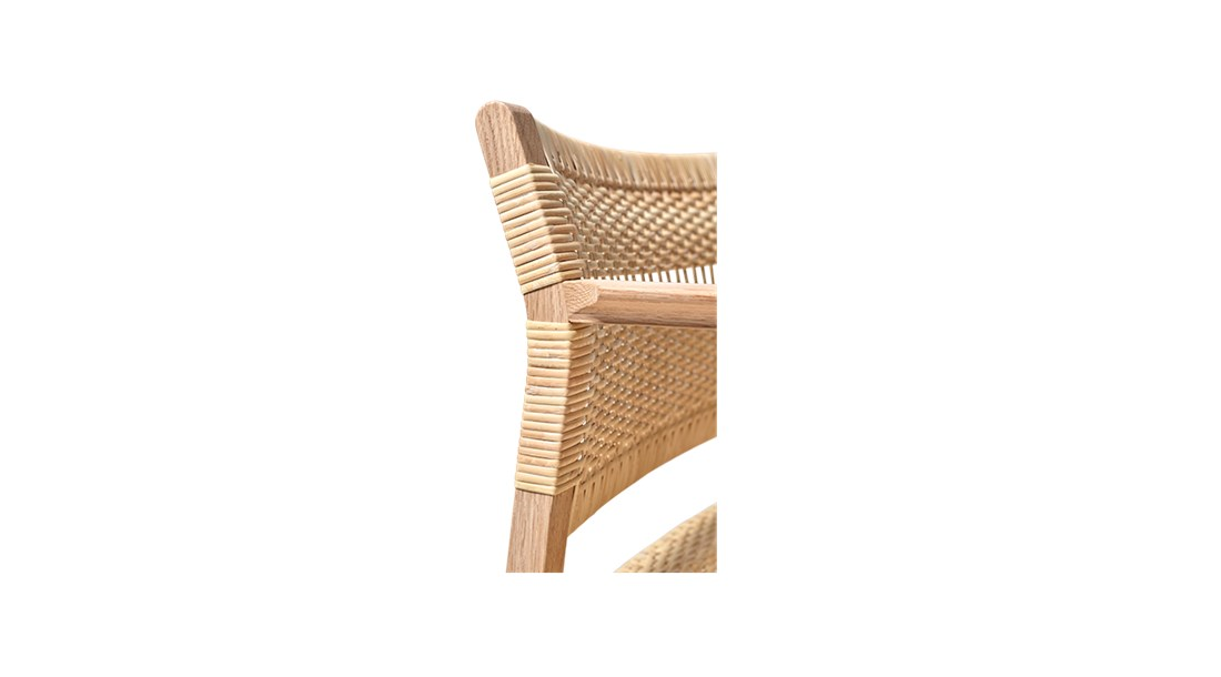 BM62 Armchair Cane Wicker - Børge Mogensen brings us back to nature with the choice of cane wicker or linen webbing coupled with a solid wood frame. In a slender design involving only what's crucial to the construction. By carefully calibrating the angle of the back rest, it's a simple yet striking dining chair that's comfortable before, during and after dinner.  Two versions in two different natural materials attest to Børge Mogensen's talent for pared-down shapes elegantly engineered for comfort. Dispensing with anything extraneous in favour of clean lines in a pure, iconic design that defies any temporary trend.   Both the BM61 Chair and the BM62 Armchair exude a certain authenticity. Designed with an exposed construction that reveals immaculate joinery and hand craftsmanship. Along with the choice of honest materials, such as natural cane wicker or linen webbing in natural or black for the seat and back together with a solid wood frame. It all reflects our expertise in materiality since our inception.   One glance at the chair in profile and you'll notice a slight angle to the rear post, which changes to provide optimal support for the back. With the lower section supporting the small of the back in an upright position, and the upper part providing support in a more relaxed position. What's more, the sledges not only ensure continuity, they're the perfect choice for soft floors.   As a dining chair, the BM61 Chair and BM62 Armchair are a comfortable seating solution for before, during and after dinner. Ideal for top-star restaurants, hotels and private homes. Choose the side chair or armchair, and you have a statement piece that is suited for galleries, museums and cultural centres. Luxury retail and residential settings, executive environments and more.  | Matter of Stuff