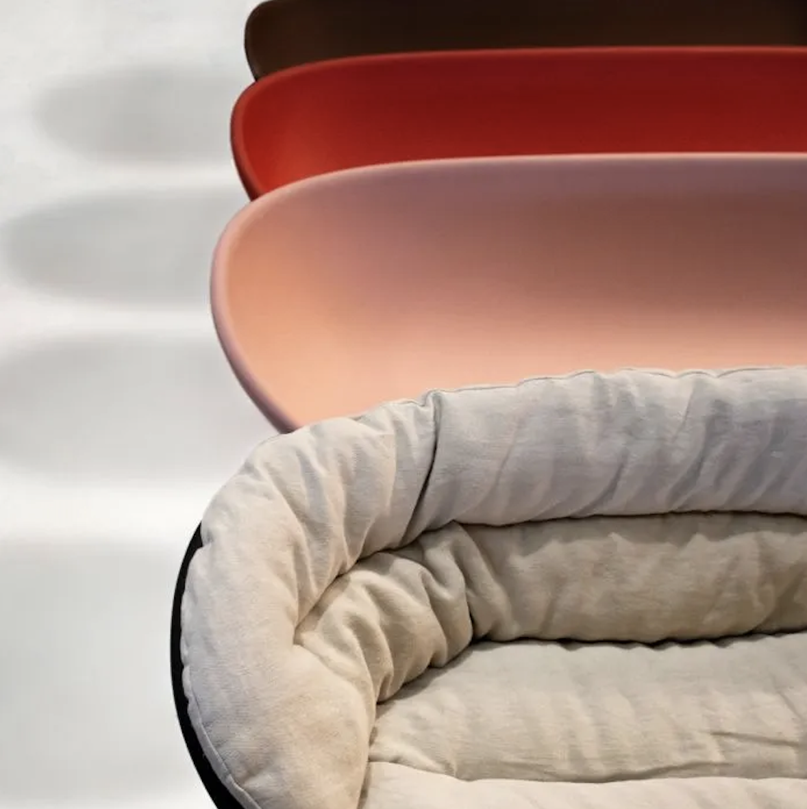 Roly Poly Sofa - The Roly Poly Collection, consisting of an armchair and a sofa, embodies the concepts of furniture and sculpture, thus representing the philosophy of Driade in a perfect way. The characteristic of these monobloc furnishing accessories is the bowl shape of the seat, rounded and welcoming, with cylindrical legs and delicately linear shapes that give it a reassuring and massive look. Made of rotationally molded polyethylene, the low seat has been enriched with soft padded cushions that nestle in its curved shape for an engaging sitting experience. Armchair and sofa are available in a variety of colours to complement any type of interior or exterior decoration.  The material with which this collection is made derives from industrial recycling coming from internal production waste, and therefore controlled, and from post-consumer recycling, that is from products disposed of with separate collection - such as PET bottles and containers, for instance - and recycled, thus giving life to new objects.  All the seats made with this material are characterized by neutral colors - such as black in particular - which makes them homogeneous. | Matter of Stuff