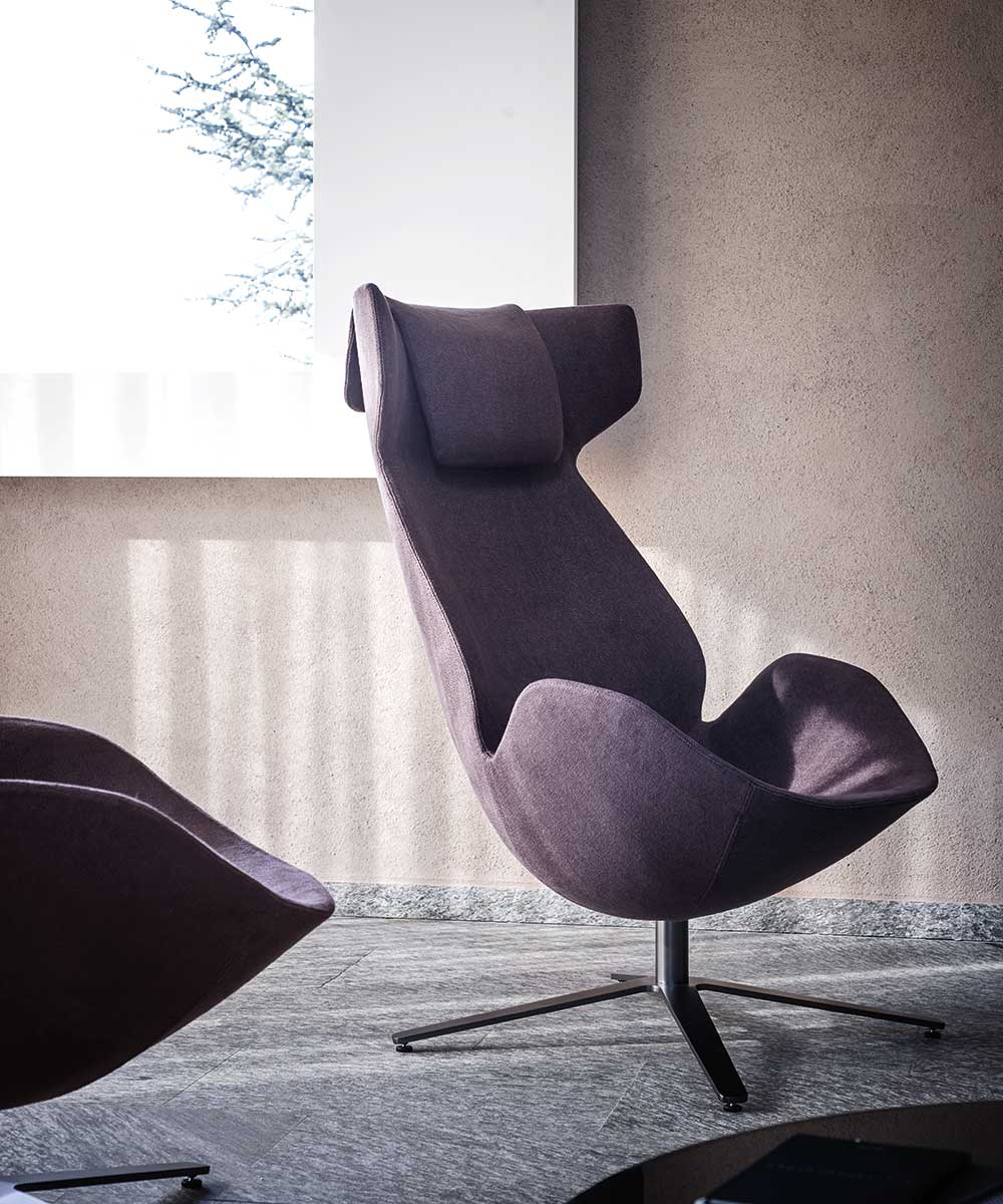 Shelter Swivel Lounge Chair - With its egg-shaped structure and the large headrest completed by a cushion, Shelter armchair is designed to embrace the body. Protective and enveloping, it is characterized by an extremely simple and light design, made of harmonic curves and thin profiles, which give to this armchair a unique charm. | Matter of Stuff