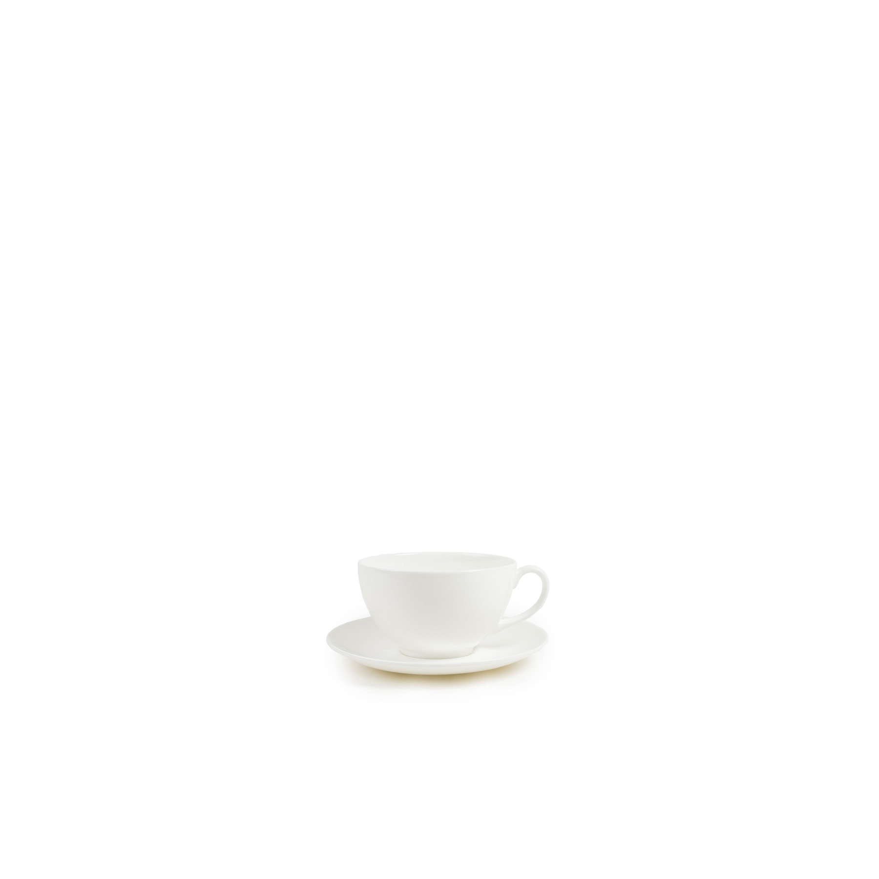 White Cup and Saucer - The purist fine bone china table ware. Designed by Chris Johnson and made in Stoke-on-Trent. This forms the base of all our collections and the most wonderful foundation for any table. Made in England. Microwave and dishwasher safe. | Matter of Stuff