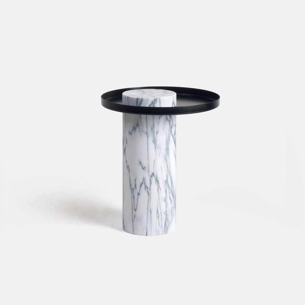 Medium Salute Coffee Table - Salute is a family of tables. Each element can be used alone (coffee table, occasional table) or combined together to play with different heights and formats as well as combinations of materials. The strong presence of the marble column is lightened by the suspended shape of the metal tray.  | Matter of Stuff