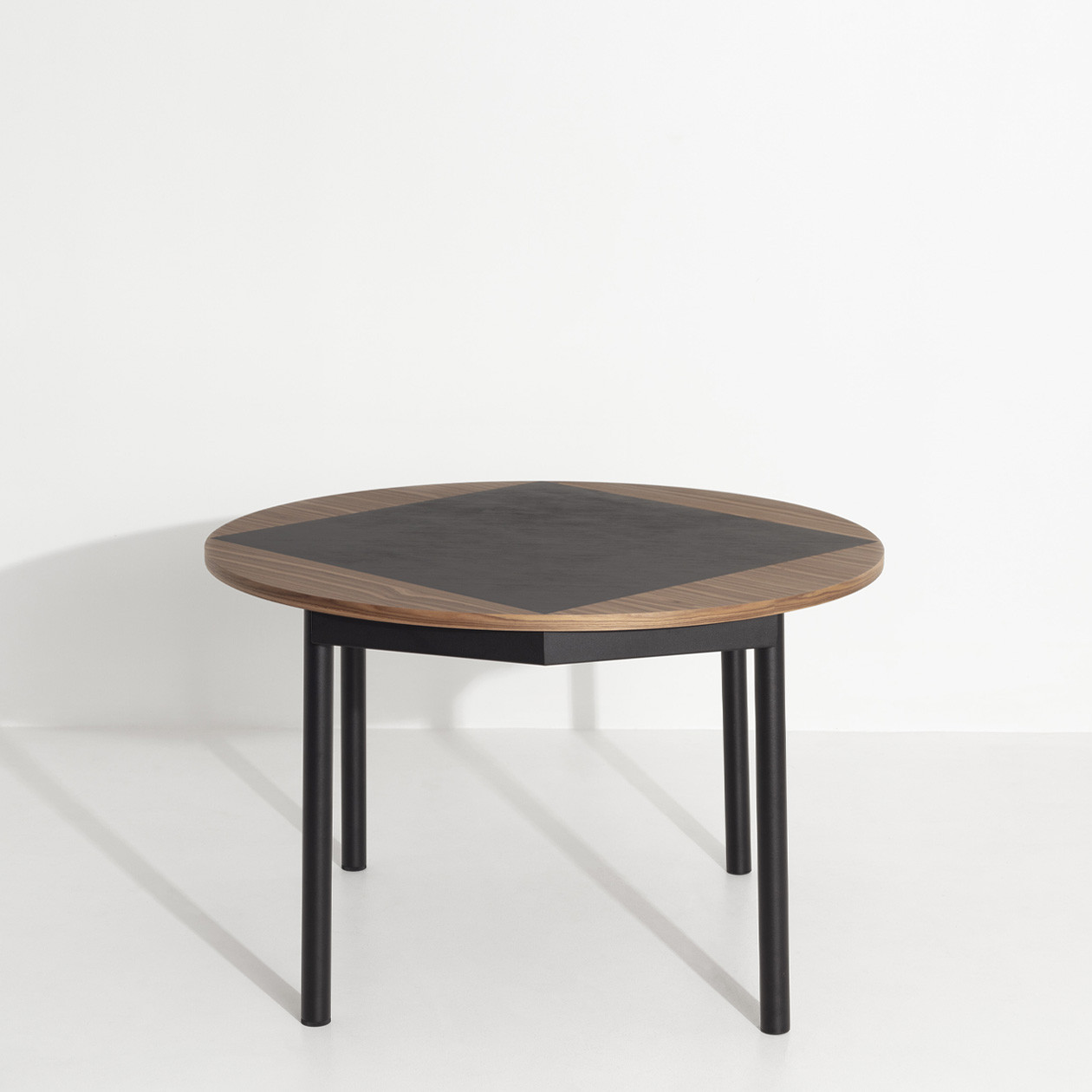 Tavla Round Wood Table - Tavla round wood table was born from the collaboration between Petite Friture team and Pool studio, a designing duo that has a faithful history with the Brand. They previously released together successful products like ISO A & ISO B side tables or the Grid sofa  Tavla inspiration comes from the personal story of Léa, who's part Iranian, and has been admiring the work on backgammon tables, Tavla being the Iranian word for backgammon.   | Matter of Stuff