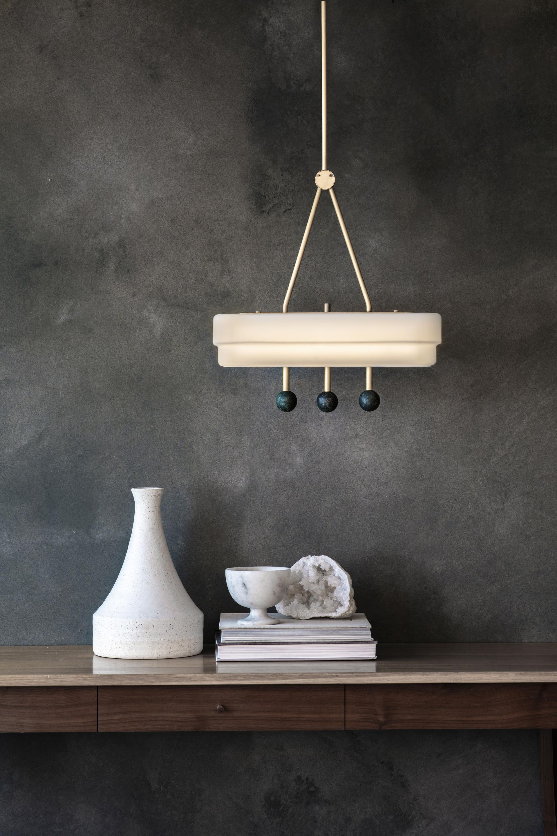 Spate Pendant Light - <p><span>Suspended from a single brass drop rod the Spate pendant produces a soft luxurious light through its stepped opal glass shade. Highlighted green or white marble orbs create an illuminated focal point.</span></p>  | Matter of Stuff