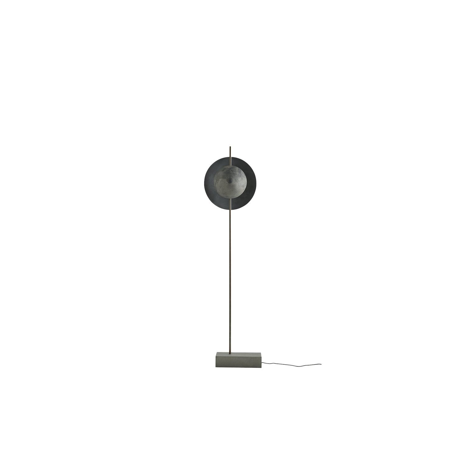 Dawn Floor Lamp - With its layered shades the Dusk and Dawn lamp series playfully divides the light into a rhythm of exposure.   The almost eclipse-like feeling contributes to an intimate and cozy atmosphere creating an art piece in itself.   By challenging the material and form of the base the Dusk and Dawn lamps has become a new way of presenting and integrate light design in interior schemes.   The raw handmade oxidized aluminum base creates stability and continuity to the lamp while the two spun oxidized aluminum shades create a geometrical and clean look that gives depth to the smooth light. | Matter of Stuff
