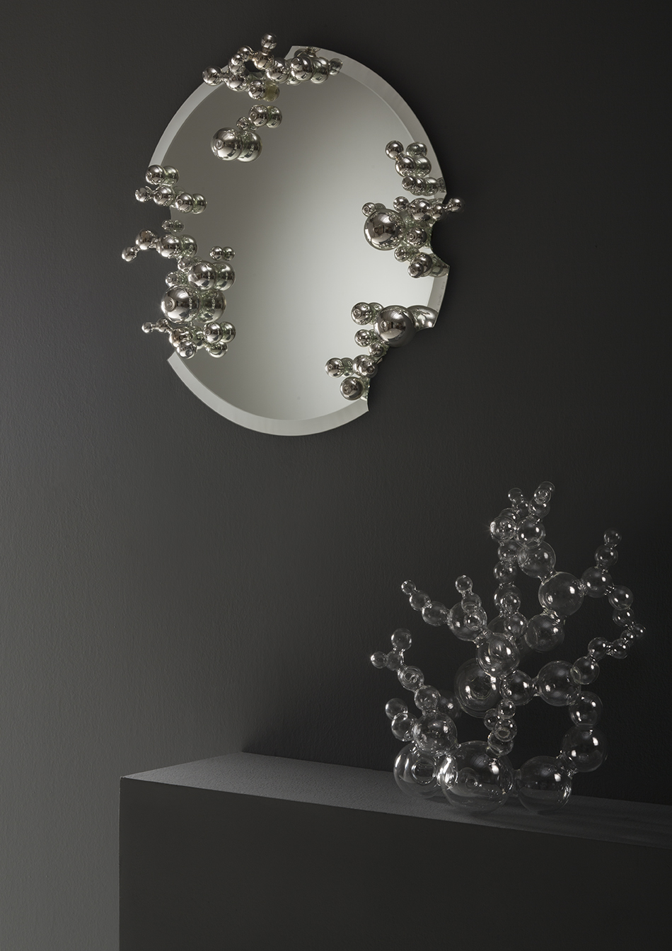 Bubble Mirror - <p>I use borosilicate glass working with the lampworking technique. I have developed a personal style that allows me to create large pieces while at the same time concentrating on the smallest details. However, the creation of the work and the technique used are only the final part of the process.</p> <p>It all starts from a sensation, a contrast, a suggestion that almost always comes from nature. As if the idea had always been there, hidden, and the experience allows me to see it for the first time and to become acquainted with it.</p>  | Matter of Stuff