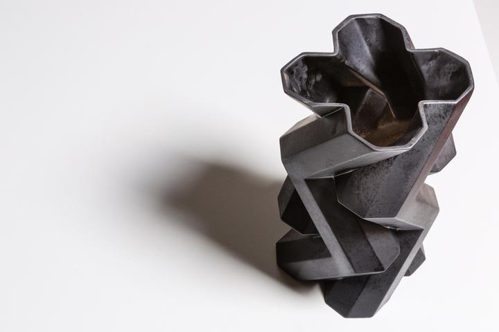 Fortress Tower Vase Iron - <p>Designer Lara Bohinc explores the marriage of ancient and futuristic form in the new Fortress Vase range, which has created a more complex geometric and modern structure from the original inspiration of the octagonal towers at the Diocletian Palace in Croatia. The resulting hexagonal blocks interlock and embrace to allow the play of light and shade on the many surfaces and angles. These are handmade from ceramic in a small Italian artisanal workshop and come in different finishes.</p>  | Matter of Stuff