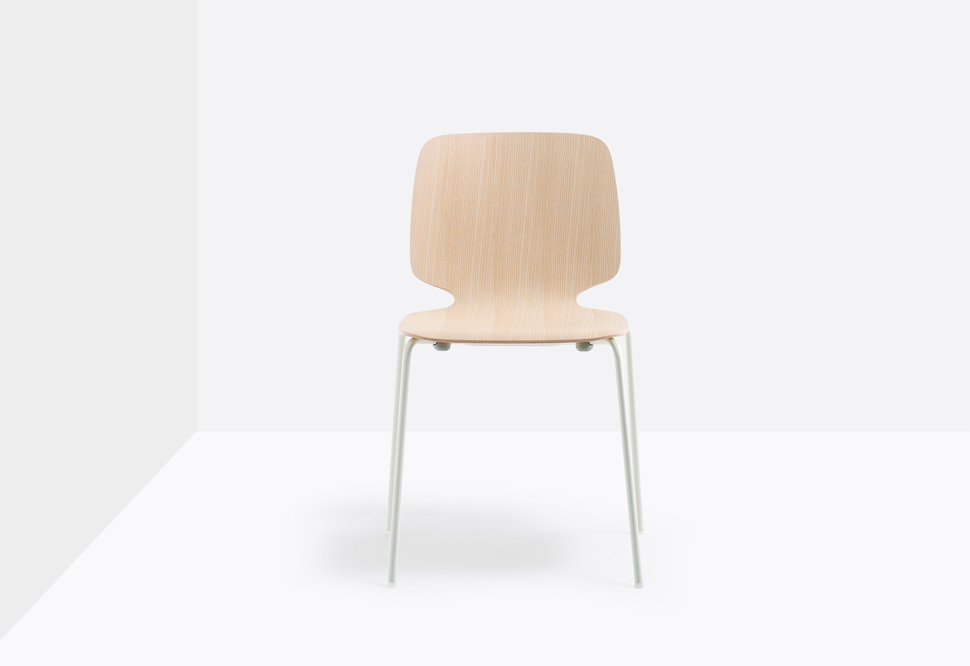 Babila Stackable Wood Chair - Babila collection is able to move along tradition and innovation with great agility. The strength of this collection is its simplicity and directness, to recall a timeless shape. Chair with ash plywood shell in variable thickness and steel tube frame Ø16 mm. | Matter of Stuff