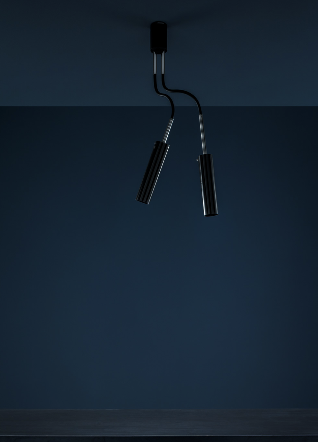 Lucenera 206 Ceiling Lamp - Lucenera was developed from a simple concept: taking the limelight off the lamp and giving centre stage to the light, depending on the subject illuminated. To achieve this, Enzo Catellani used a black carbon tube and flexible support. The shape is the simplest one possible; the object is the utmost in versatility.   Matter of Stuff