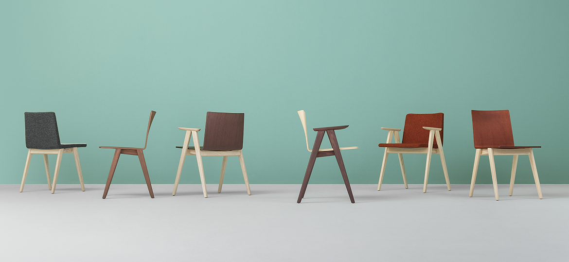 Osaka Upholstered Armchair - Osaka is a collection of seatings with a strong graphic impact whose construction elements remind the linear features of an ideogram. Armchair with upholstered shell version covered in fabric or leather, solid ash wood frame, and armrests.  | Matter of Stuff
