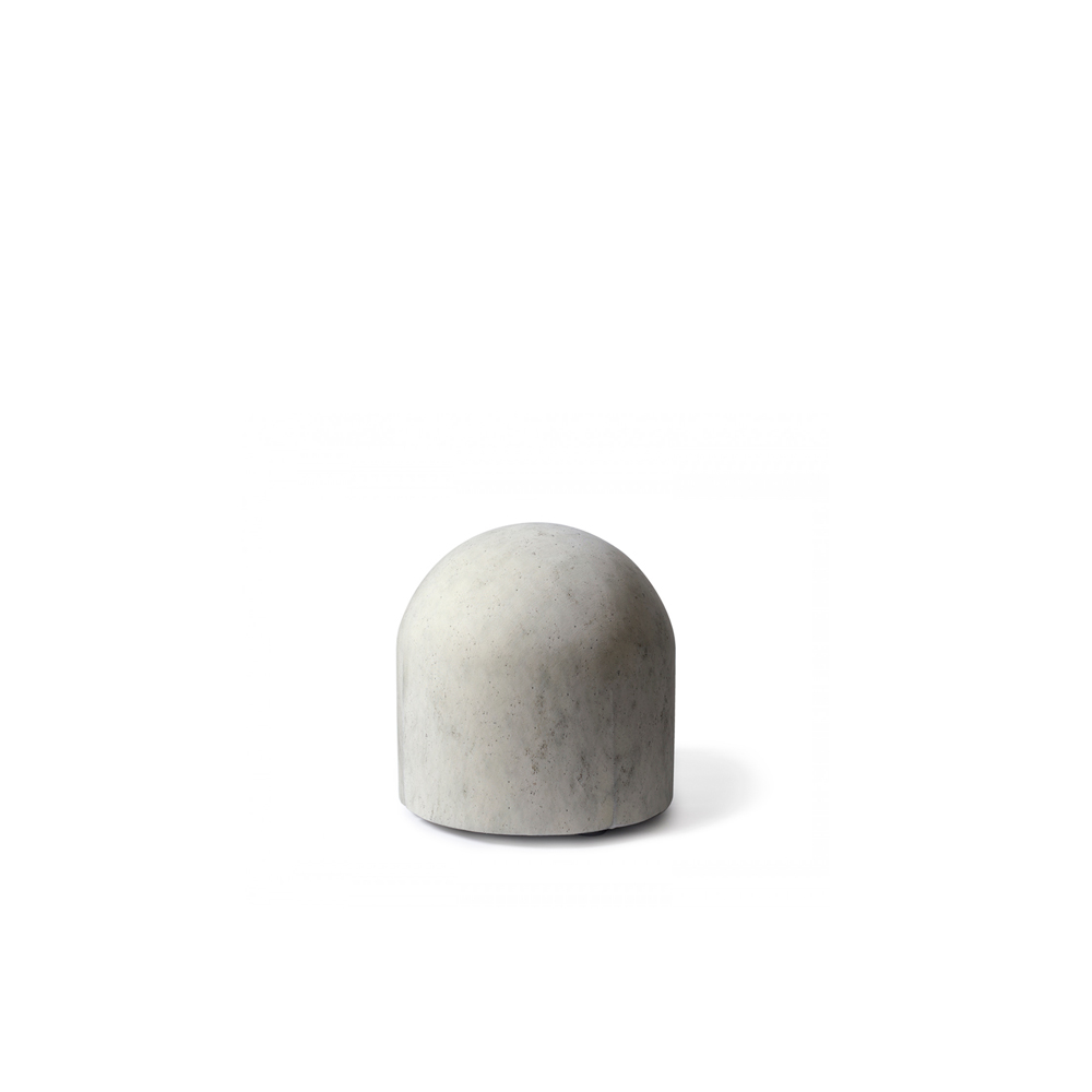 Bard Pouf - A small upholstered furniture item that pays tribute to the city of Milan. The shape and texture suggest the concrete anti-parking bollards found throughout the city, with an ironic surprise: a notoriously hard, uncomfortable object becomes soft and inviting, taking on a new appeal.  | Matter of Stuff