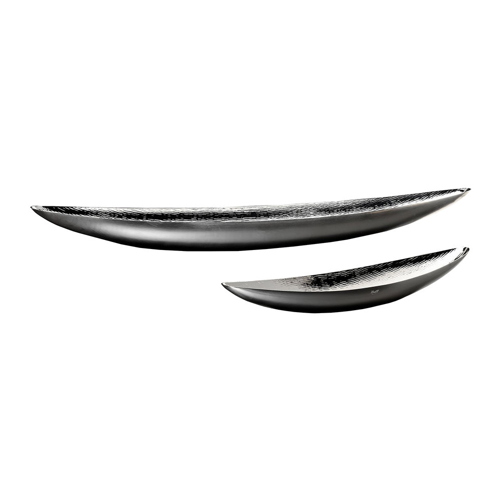 Canoa Bowl - The marvellous Canoa Bowl features a sinuous, elegant shape which can effortlessly complement either a classical or contemporary environment. The interior surface is hammered entirely by hand, creating a needle-like texture against a polished surface. The smooth exterior, in contrast, has a satin finish. Such attention to detail, both in the design and execution, results in a piece which truly stands out.  Perfectly fitting into practically any room in the house, this masterful creation brings an element of subtle sophistication in the most versatile manner.    Matter of Stuff