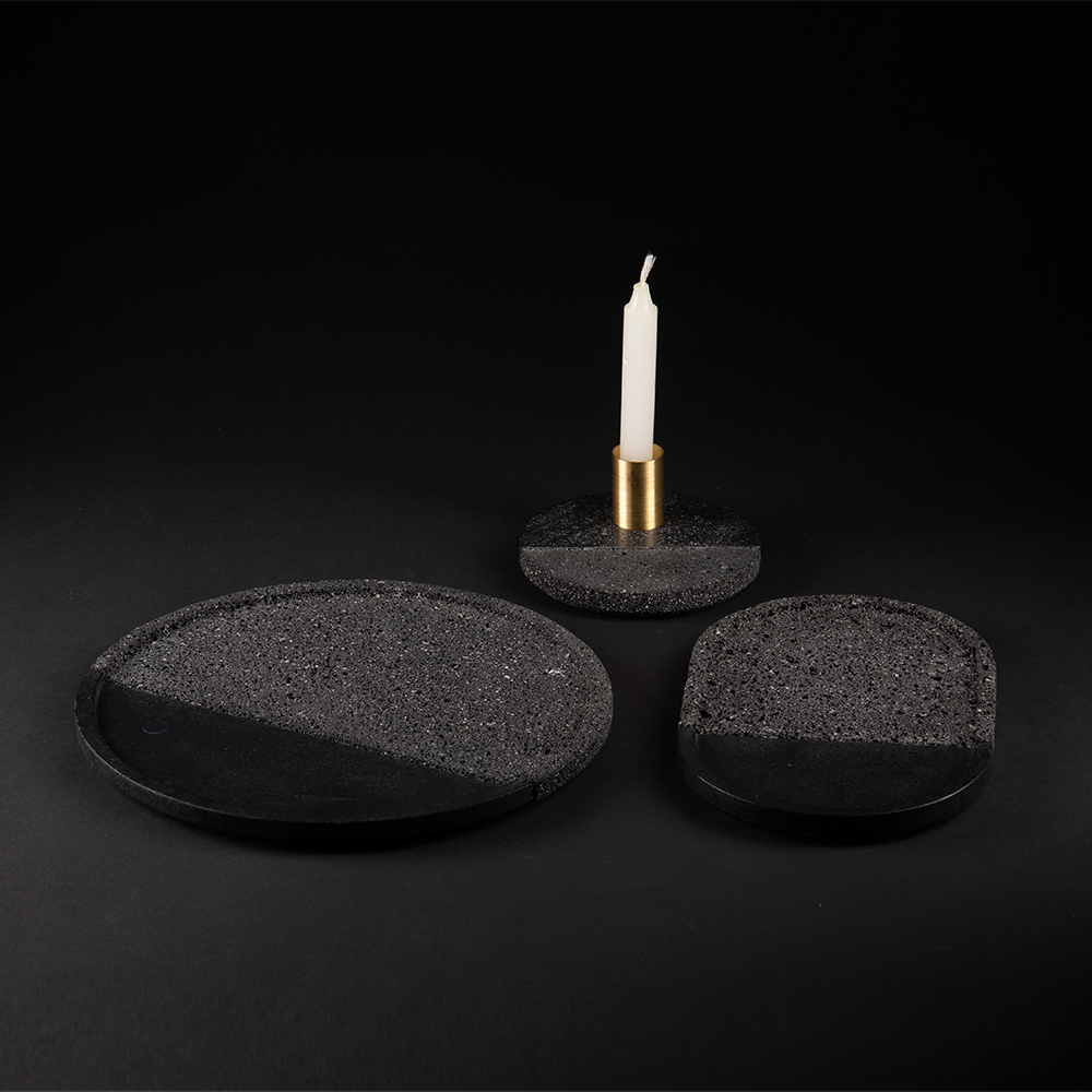 Lava Tray Set - Volcanic rock is a witness to the power of nature: hand–polished by craftsmen with a millenary tradition, its unruly nature is transformed into a sensible and human object. With their dual texture, the collection of Lava plates is as much an homage to Mexican tradition as it is a glance in the direction of modernity. A brass accent completes the harmonious balance and reveals that Lava plates are as decorative as they are functional. Available in sets of 3 plates.  | Matter of Stuff