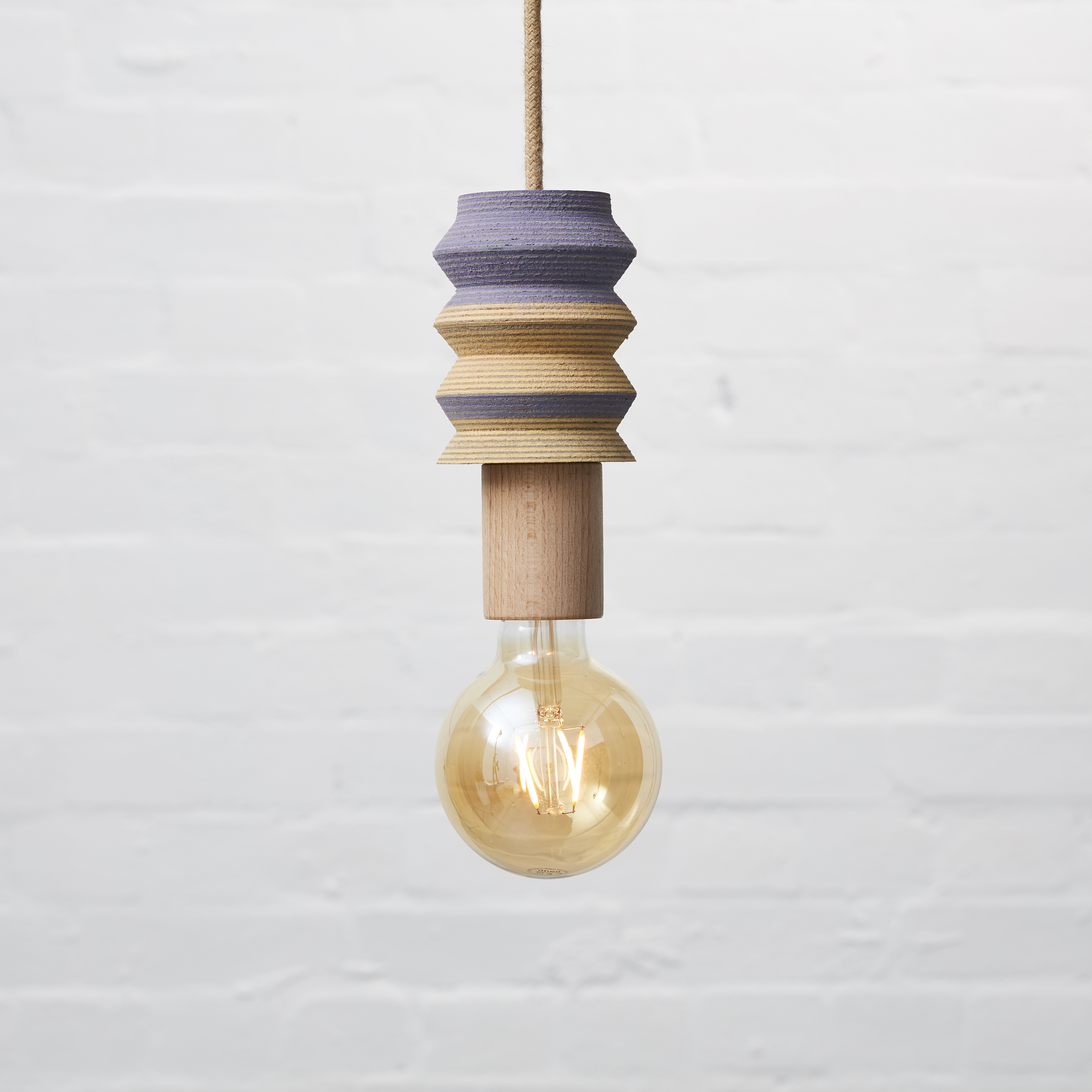 Lin pendant 2 - <p>The LIN pendant lights have been turned by hand on a lathe from blocks of laminated squares of Linoleum flooring. These playful and subtly vibrant pendants have been finished with a natural jute covered lighting cord, a solid wood E27 fitting bulb holder and a standard 3 pin plug. Statement yet welcoming lighting to brighten up interior or commercial spaces.</p>  | Matter of Stuff