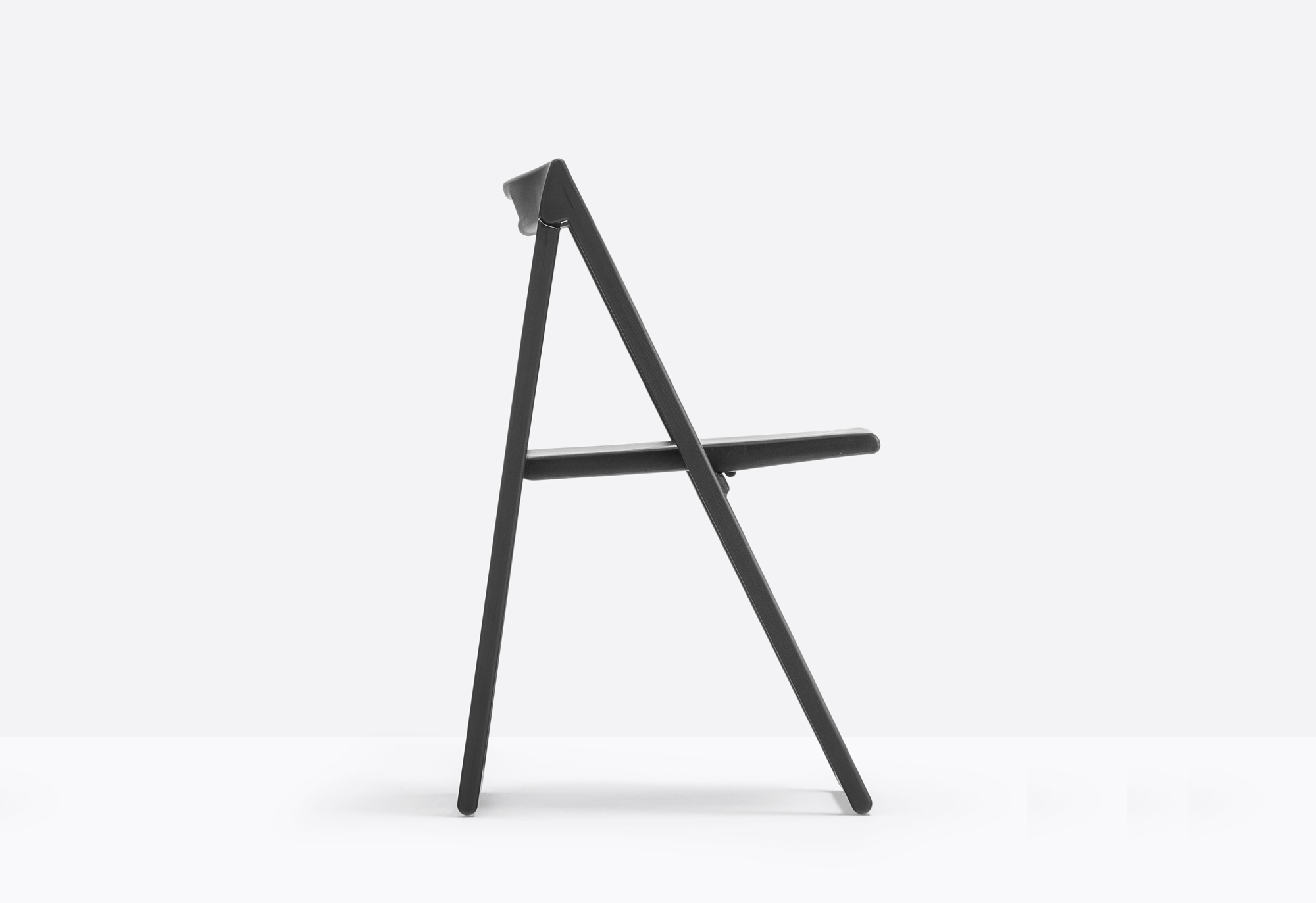 Enjoy Folding Chair - Resistant and lightweight, Enjoy is a folding chair easy to handle and carry. Once folded takes up a minimal space of 95mm. Made of polypropylene charged with glass fibre, it is suitable also for outdoor. | Matter of Stuff