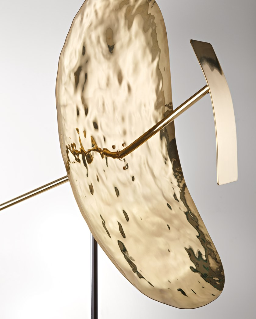 Ribot Floor Lamp - A flowing, sensible presence, delicately balanced. A sculptural object composed of a hand-hammered brass diffuser, metal that still seems to radiate the energy of the tool that shaped it. Light, originating from a LED source, is reflected as if it were liquid. Each reflection evokes the movement of water while the entire composition seems to vibrate brightly in space.  230V 50/60 Hz, LED 3000k    Matter of Stuff