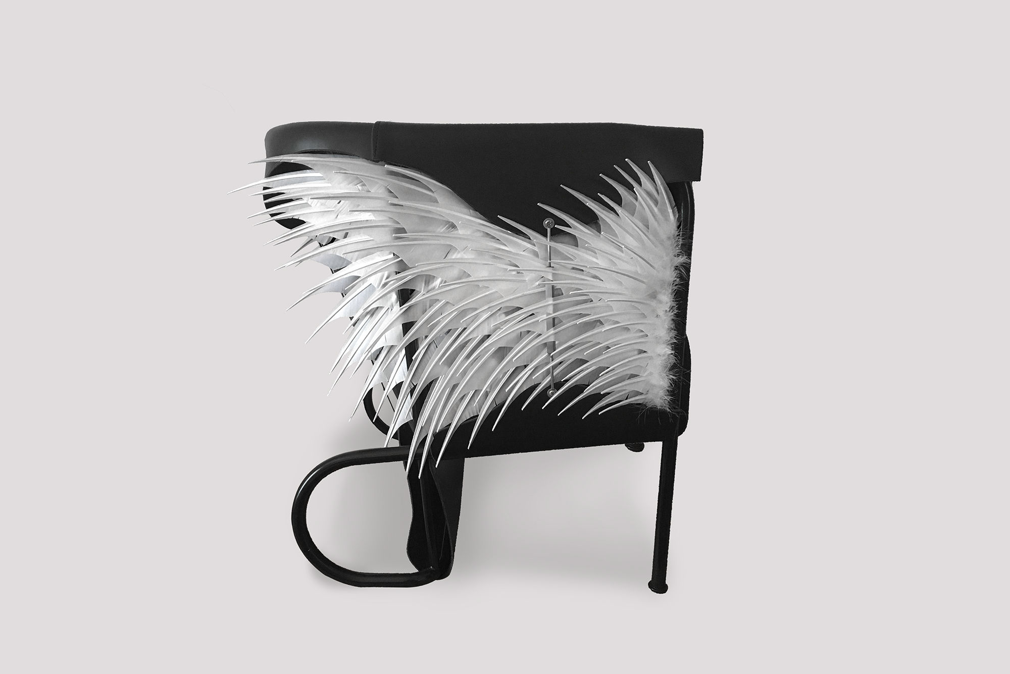 """Club Lounge Chair - Accoutre N.2 - <p>In the first edition of the 'Club Chair' (2016) the designer Glen Baghurst drew inspiration from high fashion and English saddlery and applied this to create his leather draped armchair.</p> <p>This second edition is a limited release and is designed and produced in collaboration with french Plumassier (feather artisan) Maxime Leroy. Leroy specialises in contemporary feather work and has executed pieces of Haute Couture fashion for Chanel, Givenchy, Jean Paul Gaultier and Louis Vuitton.</p> <p>In this particular case the feathers used are sourced from farmed birds. We recycled """"the waste"""" of the food industry.</p>  