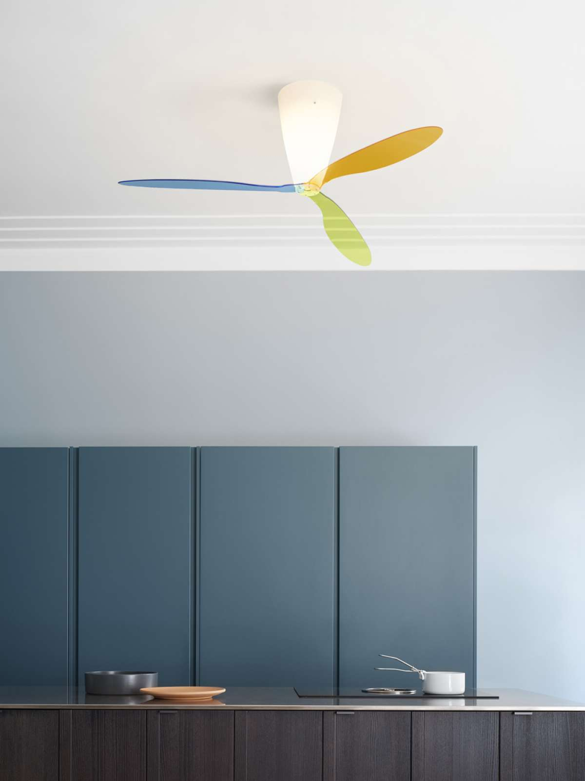 Blow Ceiling Lamp - Light in weight, essential in design, Blow moves air at variable speeds with a minimum of noise. The rotation of the coloured or transparent methacrylate blades does not interfere with the emission of white light in the room.  A special control makes it possible to invert the direction of rotation of the blades. This enables the user to regenerate the continuous, mono-directional air flow, and above all to draw the warm air from convectors downward in the winter months, significantly improving energy efficiency.  Infrared remote control is available on request please enquire   | Matter of Stuff