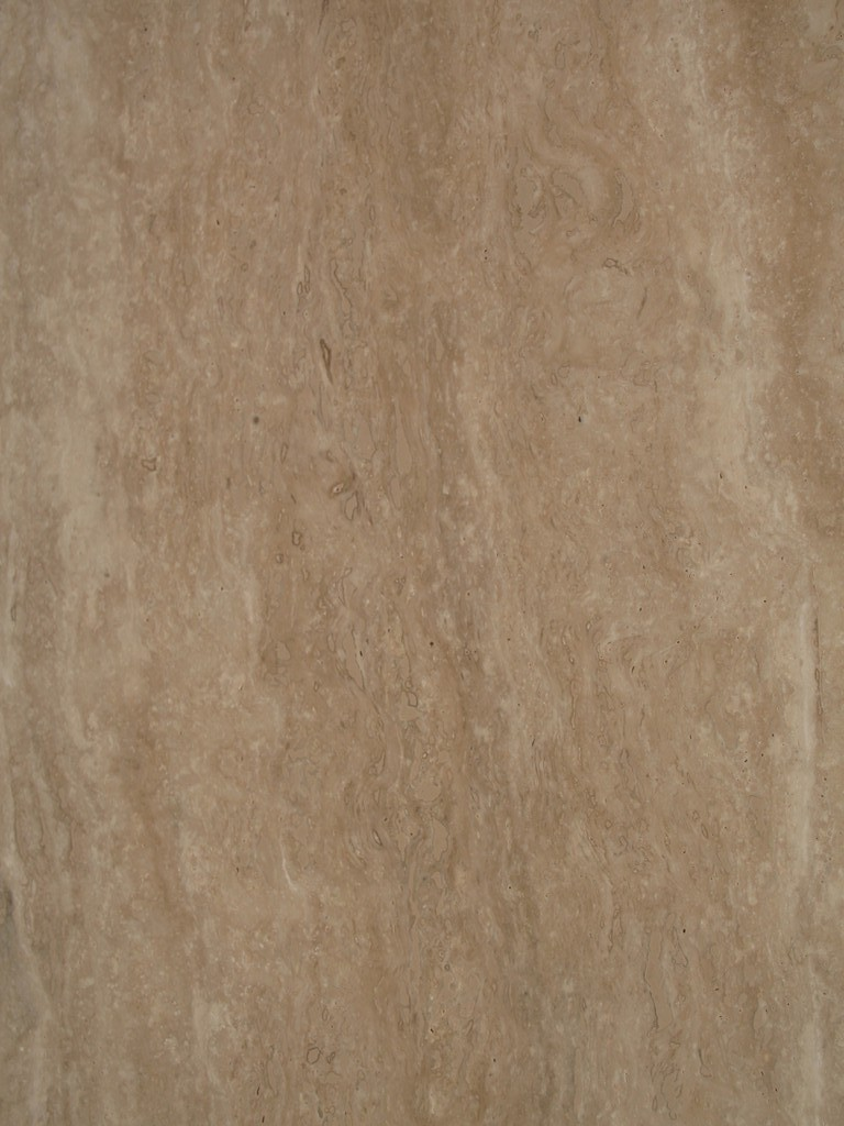 "Classic Roman Travertine - Classic travertine is a material with a uniform light beige colour . Its very high porosity brings out the  uniqueness of the natural stone, reminding us of the classical and  baroque architecture in Rome. Classic  travertine,  if cut at right angles to the grain brings out the  slightly darker veining, highlighting the compactness and homogeneity of  the structure despite the porosity. Classic travertine,  if cut  parallel to the grain, has a slightly cloudy effect in the tone on tone  colours and a much more compact look. <ul class=""dati-generali"">  	<li class=""field-carico_di_rottura_a_compressione""><span class=""label-det"">Compression tensile strength </span><span class=""value-det"">1114 kg/cm²</span></li>  	<li class=""field-carico_di_rottura_dopo_cicli_gelivita""><span class=""label-det"">Tensile strength after freeze-thaw cycles </span><span class=""value-det"">AAA1</span></li>  	<li class=""field-carico_di_rottura_unitario_a_flessione""><span class=""label-det"">Unitary modulus of bending tensile strength </span><span class=""value-det"">153 Kg/cm²</span></li>  	<li class=""field-coefficiente_dilatazione_termica""><span class=""label-det"">Heat expansion coefficient </span><span class=""value-det"">0,0048 mm/m°C</span></li>  	<li class=""field-coefficiente_imbibizione_acqua""><span class=""label-det"">Water imbibition coefficient </span><span class=""value-det"">AAA2</span></li>  	<li class=""field-resistenza_all_urto""><span class=""label-det"">Impact strength </span><span class=""value-det"">AAA3</span></li>  	<li class=""field-usura_per_attrito""><span class=""label-det"">Frictional wear </span><span class=""value-det"">AAA4</span></li>  	<li class=""field-peso_per_unita_di_volume""><span class=""label-det"">Mass by unit of volume </span><span class=""value-det"">2467 Kg/m³</span></li>  	<li class=""field-dimensione_media_blocchi""><span class=""label-det"">Average size of blocks </span><span class=""value-det"">AAA5</span></li>  	<li class=""field-uso_prevalente""><span class=""label-det"">Prevalent use </span><span class=""value-det"">AA6</span></li>  	<li class=""field-coefficiente_variazione_lastra""><span class=""label-det"">Coefficient of slab variation </span><span class=""value-det"">AAA7</span></li>  	<li class=""field-didascalia""><span class=""label-det"">Caption </span><span class=""value-det"">AAA8</span></li> </ul> 