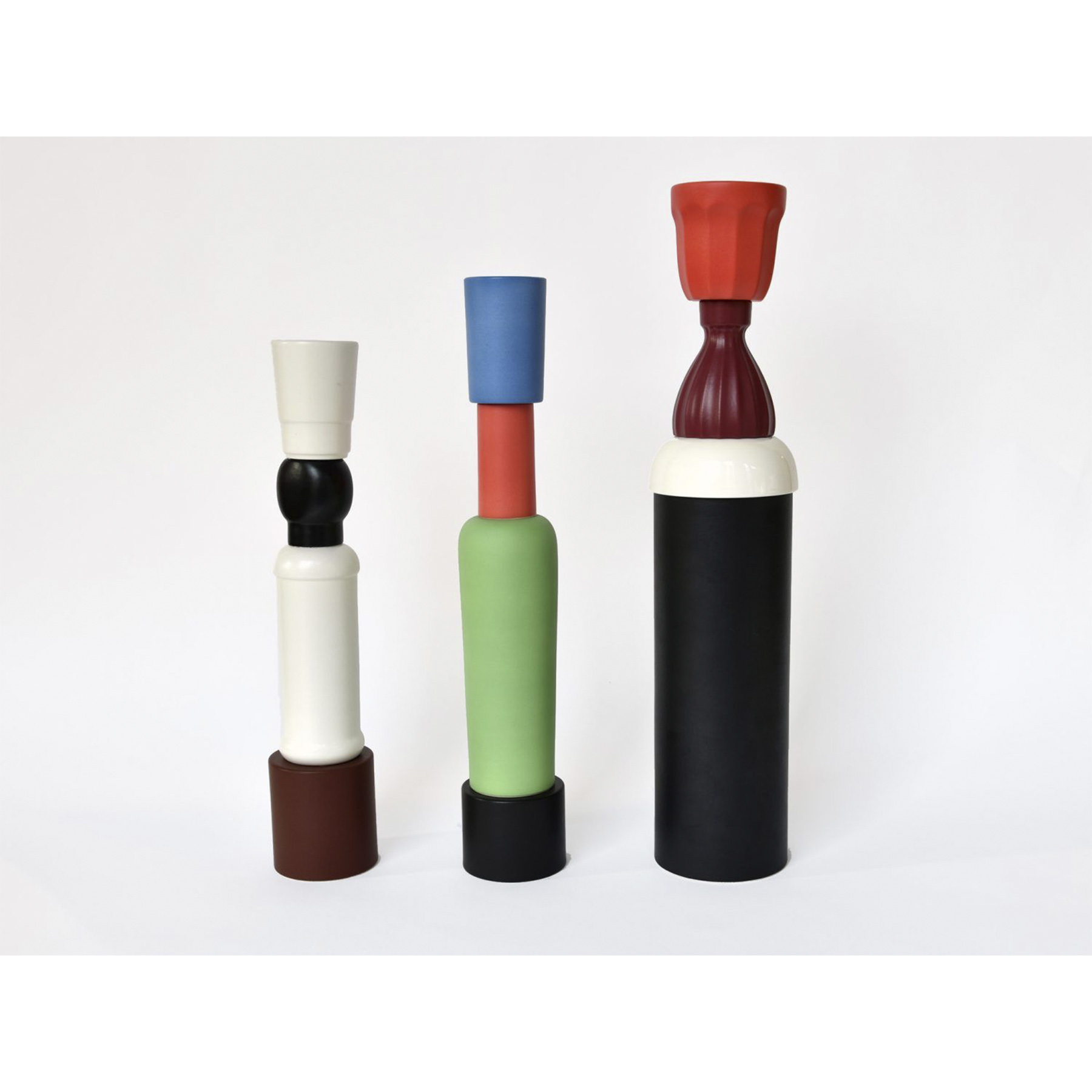Tall Multicoloured Vase - Vase Hand-turned with elements cast in white clay. Matt black, green, red and light blue glaze. Replica in 2016, this elegant vase by Natalie Du Pasquier was designed for Bitossi in 2005 and it is part of a limited series of 299 pieces. Its geometric shape is enhanced by the use of colours to highlight each part. The effect is a multicoloured, striking object with a modern allure.
