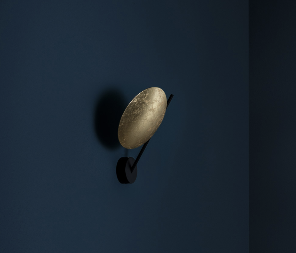 Lederam WB1 Wall Lamp - Lederam embodies the accuracy of the motion required to draw a line. The warm, softly coloured disks surround a LED module with an ultra-flat shape, which creates thin lamps and suspended forms with curved, sinuous lines. | Matter of Stuff