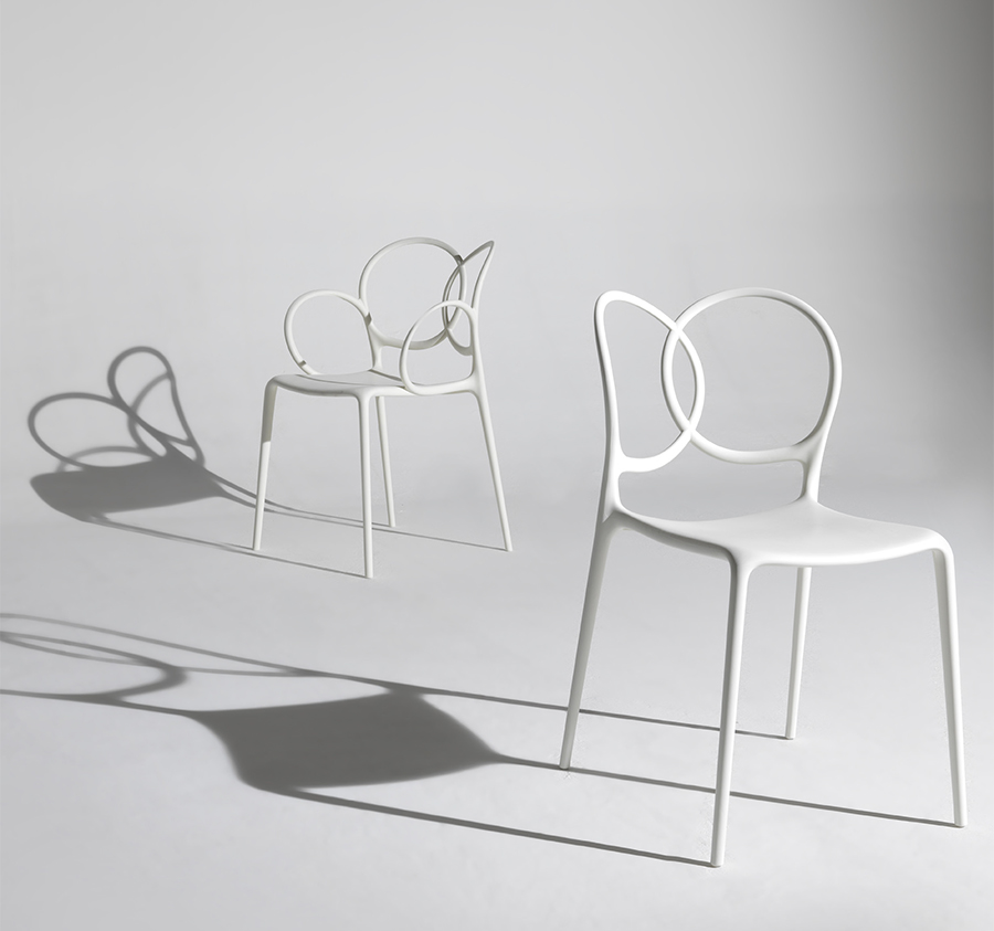 """Sissi Armchair Green Collection - Sissi is a sculptural, very versatile, self- centred and contemporary piece. """"Its modern design winks cheekily at the past and at the female world. The merging and intersecting rings look as if they have been bent by the hand of the viennese craftsmen, whom since over a century ago, would offer the world an elegant and design archetype. The connections, linked in such a sensual way, turn sissi into a refined and sculptural piece, just like the ultimate viennese chair - famous for its wooden curves- it is inspired by. Just like a confident, self-assured women changes her clothes to suit her mood, this chair is complemented by an essential part of its design, the seat cover.""""Ludovica and Roberto Palomba.  The material with which this collection is made derives from industrial recycling coming from internal production waste, and therefore controlled, and from post-consumer recycling, that is from products disposed of with separate collection - such as PET bottles and containers, for instance - and recycled, thus giving life to new objects.  All the seats made with this material are characterized by neutral colors - such as black in particular - which makes them homogeneous.   Matter of Stuff"""