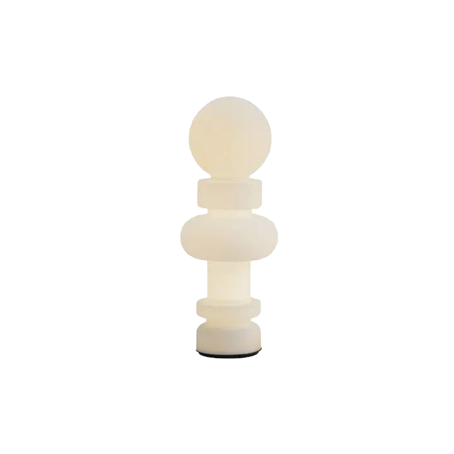 Re Table/ Floor Lamp - Inspired by the game of chess with their sinuous shapes, Re and Regina are the key characters of the chessboard. Their profiles stand out clearly in the white light diffused by opalescent glass. Real individuals, they play in pairs alternating spheres, cylinders and rings of light. Vertical the King (Re), horizontal the Queen (Regina). They can be placed next to each other or in different spots in the same room, be used as floor or table lamps, on a coffee table or a desk, both Re and Regina have the presence to create a context. The dimmer allows to modulate the light making it a surreal element with different degrees of intensity: an element of representation that releases energy in space when the light is bright, abstract and restful when the light is soft and low. Glass sculptures during the day in environments illuminated by natural light. Re and Regina are inspired by the history of art, from Cosmè Tura to the Flemish interiors of Jan Van Eych to the conceptual imagery of Marcel Duchamp who plays chess as a lifestyle. Re and Regina are Cartesian axes of a universe that crosses ages and cultures. In 2020 FontanaArte reintroduces these glass lamps as a sign of the expressive wealth contained in the great repertory of ideas that is the FontanaArte catalogue and, most importantly an homage to the talent of an artist who had a gift for calibrating the formal tension of a utilitarian object on a quest for unity among the arts.  Dimmable diffused-light table or floor lamp. Painted metal frame. Diffuser in satin-blown glass.  Black power cable, dimmer and plug. Power supply with interchangeable plugs (europe - usa). Integrated LED. | Matter of Stuff