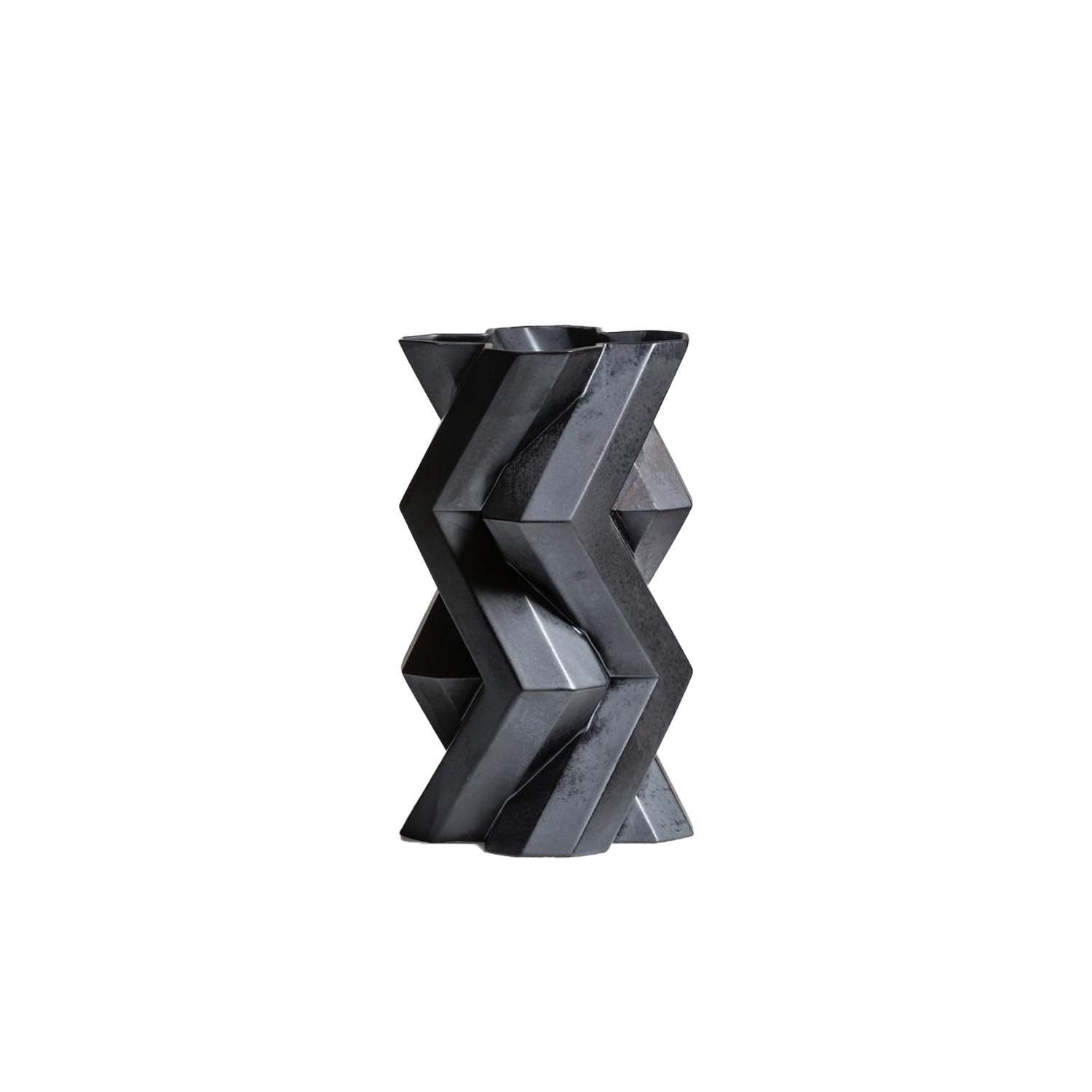 Fortress Tower Vase Iron - Designer Lara Bohinc explores the marriage of ancient and futuristic form in the new Fortress Vase range, which has created a more complex geometric and modern structure from the original inspiration of the octagonal towers at the Diocletian Palace in Croatia. The resulting hexagonal blocks interlock and embrace to allow the play of light and shade on the many surfaces and angles. These are handmade from ceramic in a small Italian artisanal workshop and come in different finishes.  | Matter of Stuff