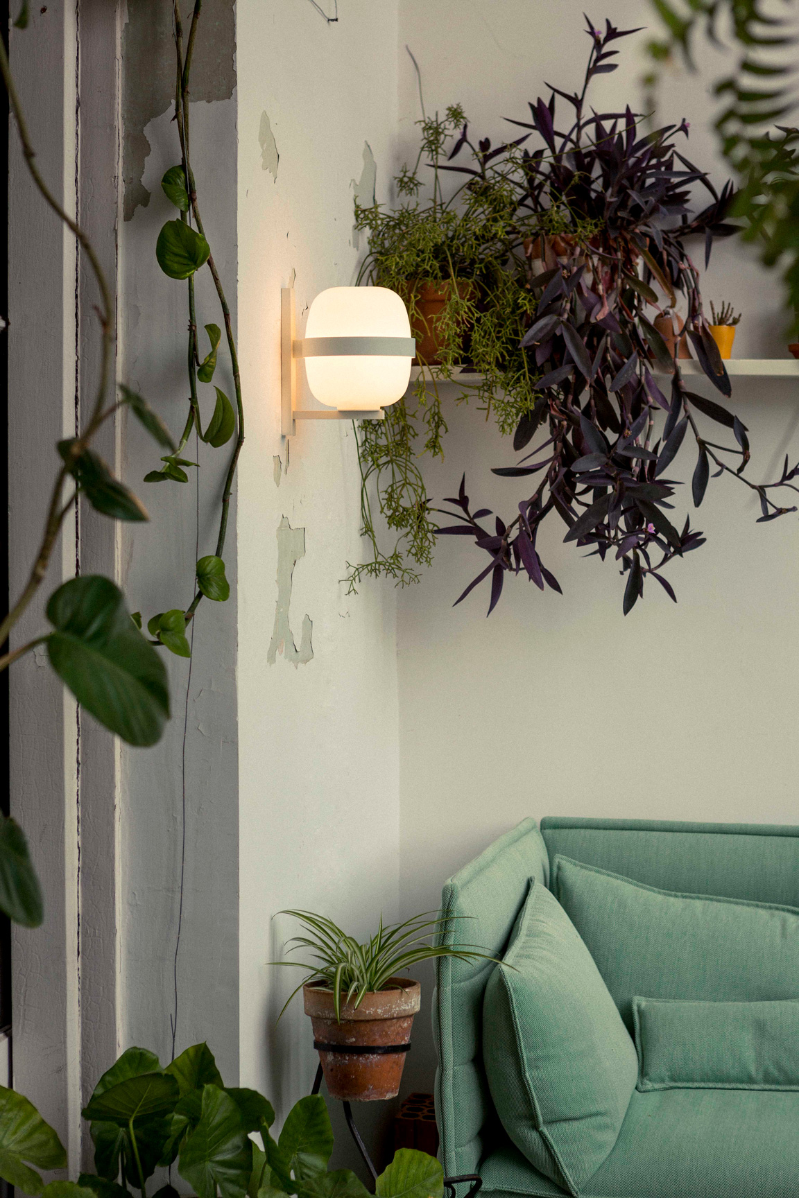 Wally Wall Lamp - <p>Wally is an iconic wall lamp that shares the same opal globe shape and formal elegance. The structure, available in matt white or dark bronze finishes, is fixed to the wall via a metal arm and ring that wrap around and support the glass shade.</p> <p>The Wally wall lamp adds a distinguishing touch to any setting. It provides a diffuse and soft illumination for both indoor and outdoor spaces.</p>  | Matter of Stuff