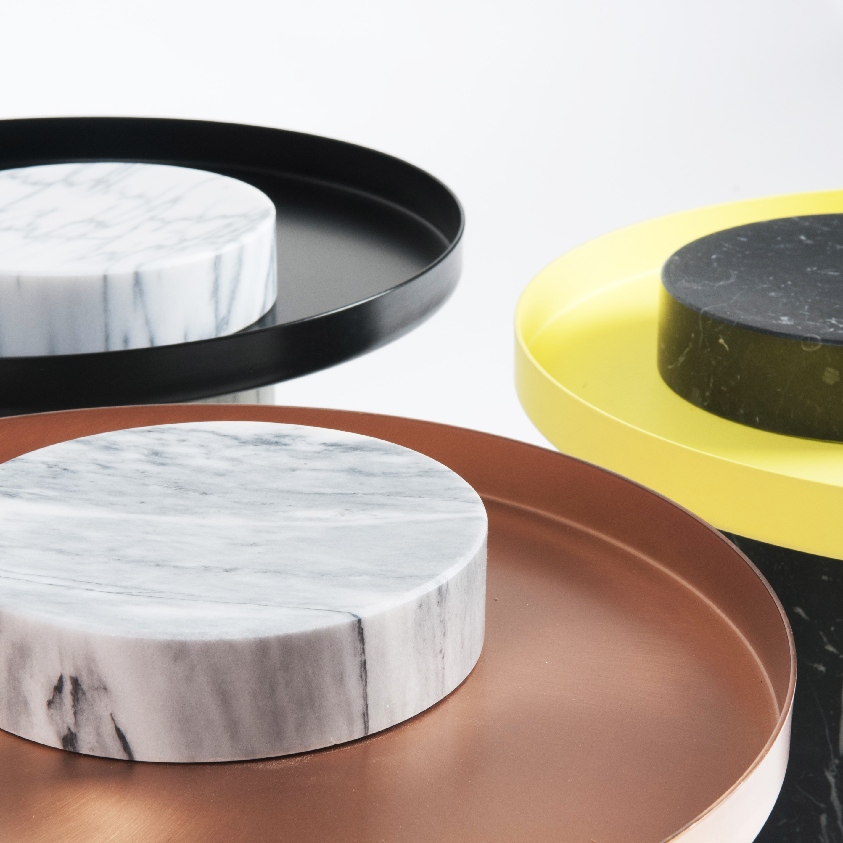 Medium Salute Coffee Table - <p>Salute is a family of tables.<br /> Each element can be used alone (coffee table, occasional table) or combined together to play with different heights and formats as well as combinations of materials. The strong presence of the marble column is lightened by the suspended shape of the metal tray.</p>    Matter of Stuff