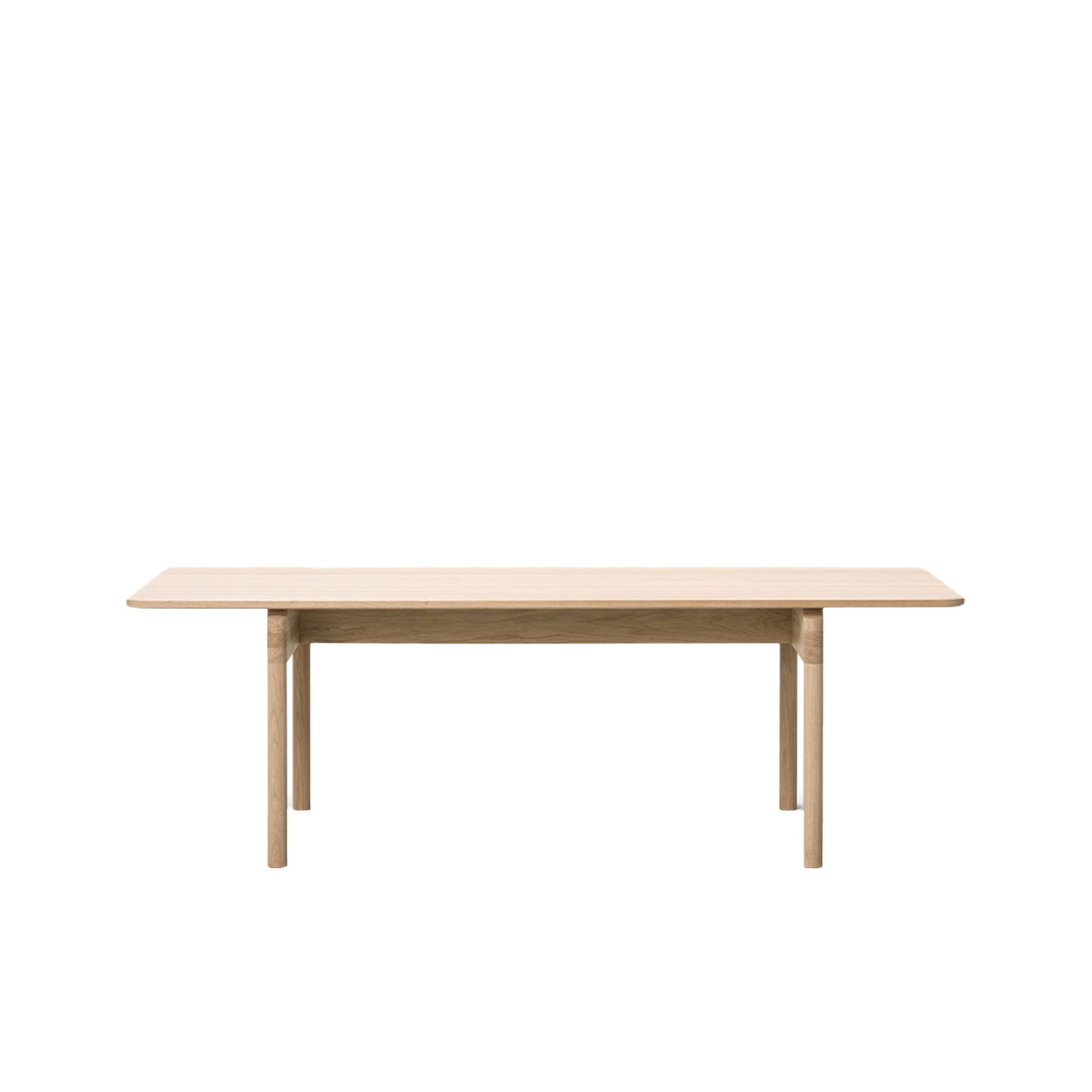 Post 6438 Dining Table - With its long rectangular table top and sturdy cylindrical legs, the Post Table is the perfect merging of functionality, simplicity and serenity in a classic design expressed with modern minimalism. The structural frame is exceptionally crafted in solid wood, teamed with a table top in solid oak. Enjoy loads of leg room in the wide space between the legs on either end, adding to the appeal of this practical, tactile table for dining or meeting in a residential, corporate or hospitality setting.  The Post Collection is an example of eliminating anything extra in order to solely focus on the essential. For designer Cecilie Manz, creating is about examining the purpose of a piece of furniture. Stripping the concept down to only what's necessary, the form emerges from the function in an expression that's pure and purposeful.  It's this simplicity imbued with a sense of beauty that is at the core of the new Post Collection from Manz. The name is a nod to the former home of the Royal Mail, renovated into our flagship showroom in Copenhagen Clean, uncluttered lines are the signature traits of the Post Table and Post Chair, each boasting a solid wood frame that reflects our heritage of wood craftsmanship and appreciation for authentic materials.  The Post Chair is upright and unassuming, with clean, classic lines. The plywood seat and back are light yet sturdy, while the arms offer just enough support with a minimal use of space. Add to that the option of an upholstered seat in leather or fabric, and you have a subtle design that could easily fit into a residential setting, restaurant, café or corporate environment.   The perfect partner is the Post Table, featuring a long rectangular table top and matching cylindrical legs. The solid wood frame provides a stable structure for the streamlined table top available in solid oak. Given the placement of the legs on either end, the result is loads of leg room. An extra advantage to the appeal of this prac