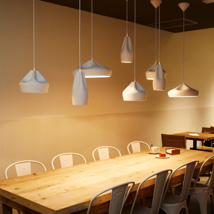 Pleat Box 13 Pendant Light - <p>The idea behind the Pleat Box is a sophisticated combination between a digitally designed crease in a piece of cloth and a silhouette that is applied to a ceramic base.</p> <p>The outer part of the lamp is offered in white ceramic, brown, black, terracotta, and grey– the direct result of recycling different enamels. The interioris available in brilliant white enamel, whichenhances the luminous light from the lamp,or 24k gold, which generates an extremelywarm light. </p> <p>The Pleat Box collection is now available with an integrated LED technology, which projects indirect light and prevents glare.</p>  | Matter of Stuff