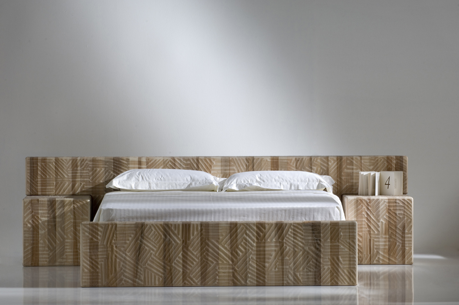 """Orfeo Bed - <p>Orfeo is a bed with juxtaposed monolithic blocks, made using vertical grain wood. It is manually finished on all sides using a gouge. The entire manufacturing and finishing process is carried out manually in our workshop. The wood used for this piece is Juglans Regia – common Italian walnut; not dried but """"raw"""". This wood belongs to the Latin tradition of furniture-making and features an extremely compact fibre which can, however, be worked without too much difficulty; it is therefore highly suitable for household items. Over time the wood hardens and becomes extremely resistant, and oxidises slightly to take on a progressively warmer amber colour.<br /> Customised and made with Linden wood, European cherry, Slavonian oak, maple.</p>  