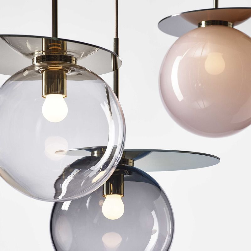 Umbra Pendant Lamp - <p>Inspired by the relationship between geometric objects and their shadows, the Umbra collection features elegant pendants in sophisticated detail. Its metal plate derives from the perfectly elliptical shadow cast by a side-lit ball, mirroring the colourful mouth-blown crystal piece. The glass parts of umbra are mouth-blown thus the intensity of colour and gradient may slightly vary.</p>    Matter of Stuff