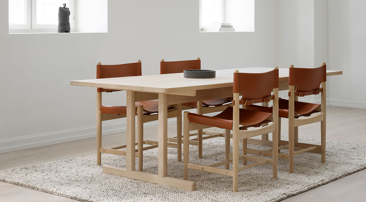 The Spanish Dining Chair - The Spanish Dining Chair is a testament to the application of honest materials. Crafted from the finest selection of oak and flawless saddle leather, the chair is available with or without armrests, and with multiple finishes from light to darker shades, depending on the atmosphere you want to create. | Matter of Stuff