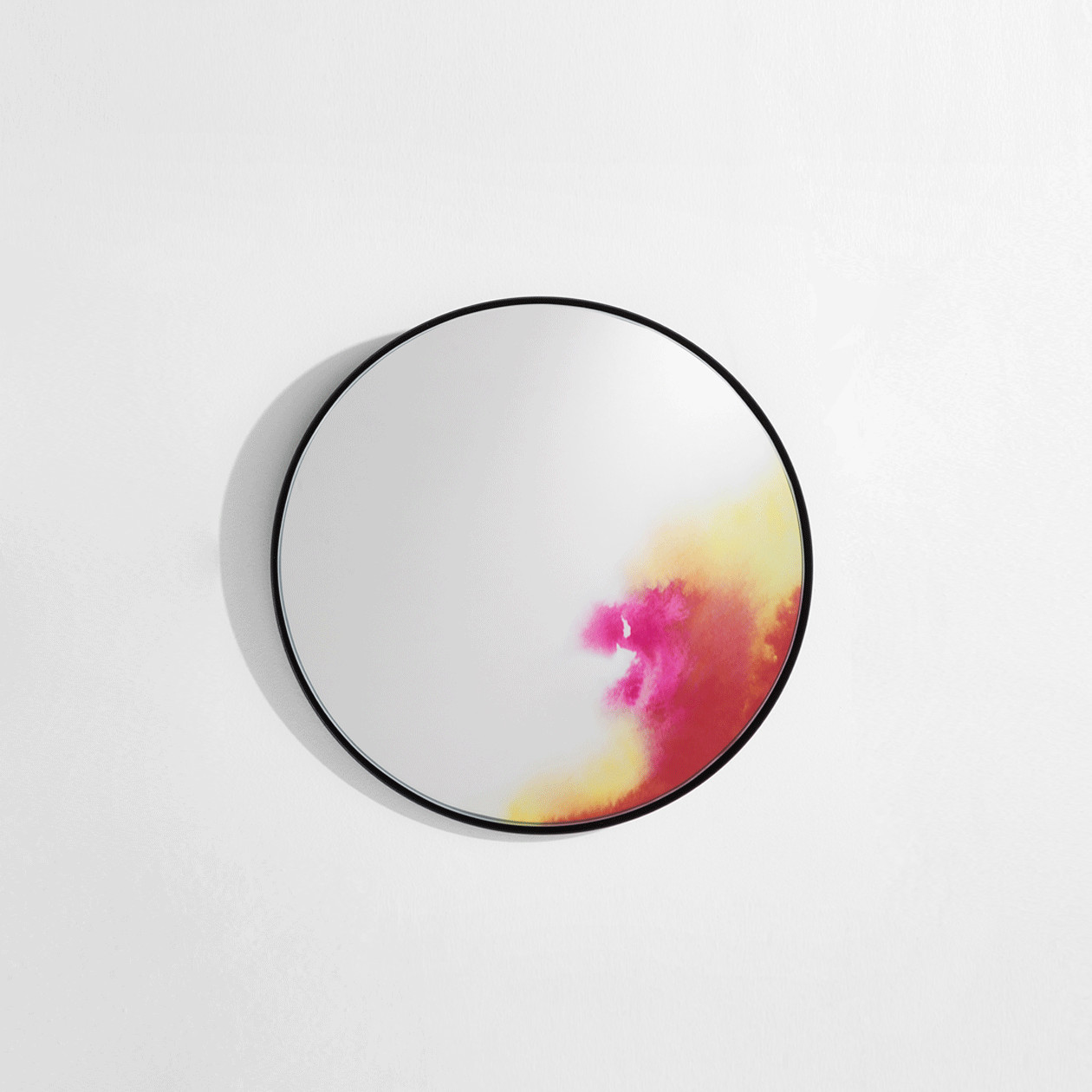 Francis Wall Mirror - Pink S - The wall mirror Francis evolved from an experience with pigmentation. The shifting colours on the periphery suggest the oxidation of antique mirrors or hues on a makeup palette. This observational design, with vivid and deep colours, is reflected inside the surface of each mirror by digital printing. The back of the mirror, slightly convex, is suspended through the centre, which allows the mirror to fall forward such as with venetian mirrors.  | Matter of Stuff