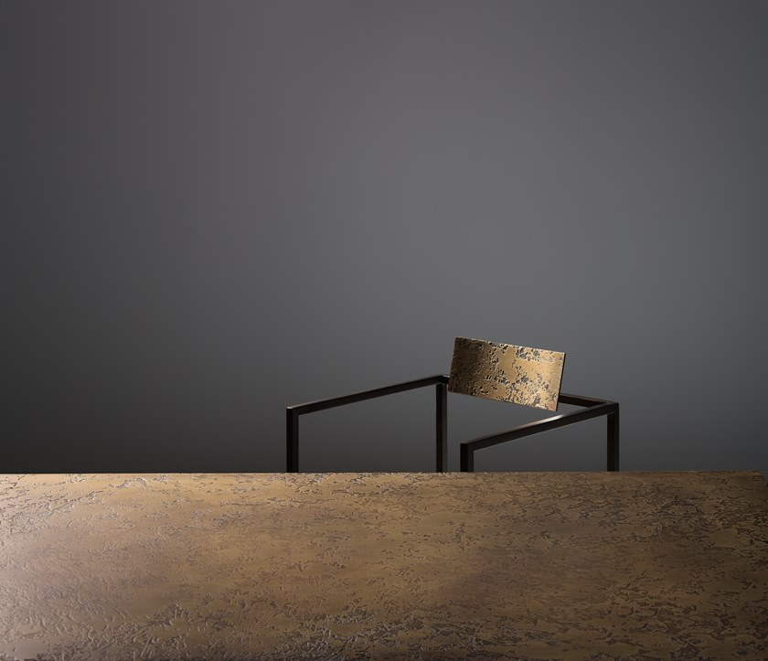 Riviera Table - Dining table with tubular metalstructure.  What makes this collection of minimal, geometric tables and chairs (easily adapted to any space) truly unique is the texture of their surfaces, quite evident when seen close up. Contrasting with the slenderness of the burnished steel frame, the planar surfaces are covered in brass or DeLabré copper, leaving room for surprising variations of the material, which reveals its full potential. Furniture becomes a palette, where the hand of the craftsman draws the many faces of metal. | Matter of Stuff