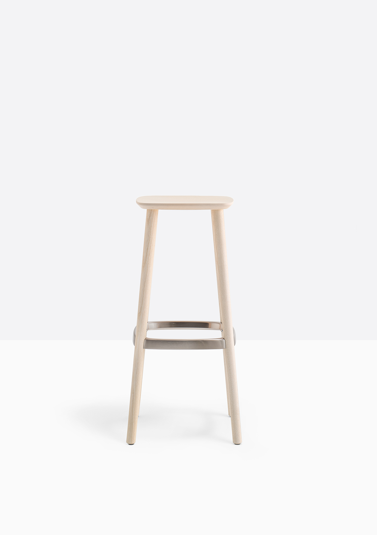 Babila Stool Tall - <p>Babila collection is able to move along tradition and innovation with great agility. The strenght of this collection is its simplicity and directness, to recall a timeless shape. Ash wood barstool with tapered legs that perfectly join the plywood seat. Die-cast aluminum footrest. Height 650mm.</p>