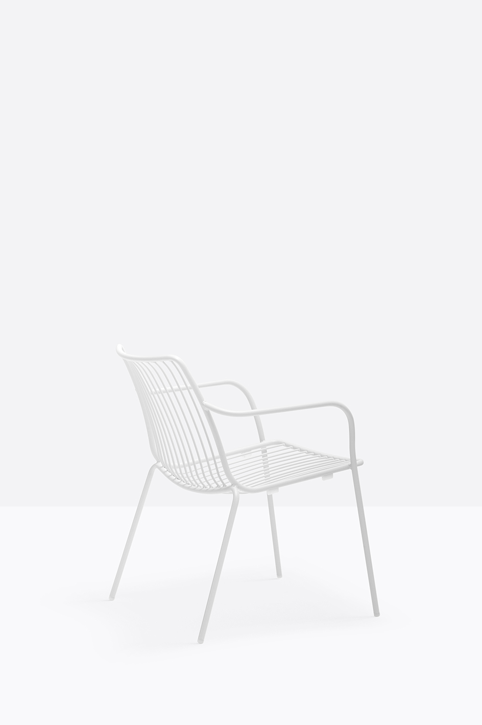 Nolita Lounge Chair - <p>Nolita is a family of outdoor seatings which recalls the origins of a historic course started by Mario Pedrali in 1963 with his first metal garden chairs. Lounge armchair with steel tube frame powder coated for outdoor use.</p>  | Matter of Stuff