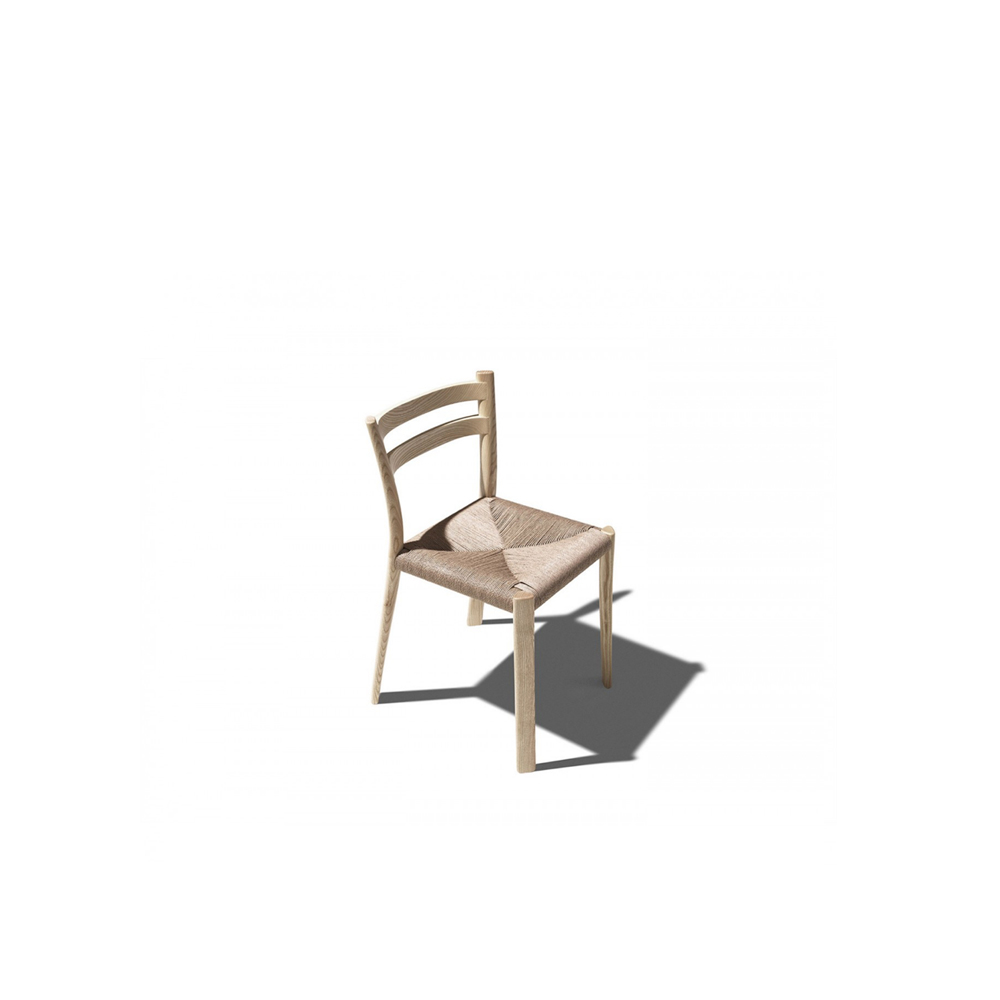 """Buri Chair - Chair in solid ash wood with handwoven paper cord seat. Though Buri is based on the traditional """"Friulana"""" model found in many Italian homes, restaurants and taverns, it differs from this archetype thanks to the ample size of the seat, and sophisticated details of the highest crafted quality like the smooth joining of the crossbars with the posts.    Matter of Stuff"""